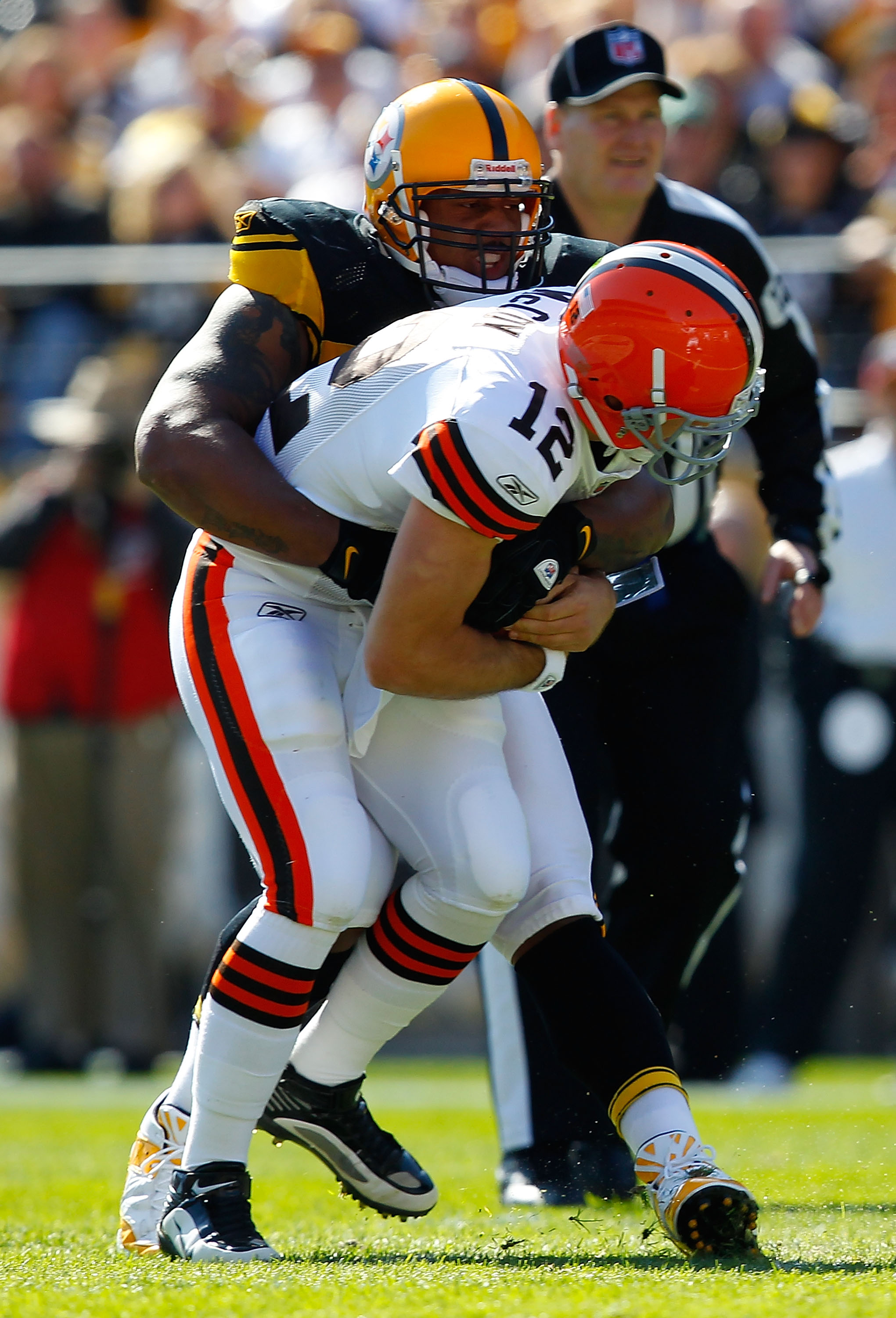 PITTSBURGH - OCTOBER 17:  LaMarr Woodley #56 of the Pittsburgh Steelers sacks Colt McCoy #12 of the Cleveland Browns during the game on October 17, 2010 at Heinz Field in Pittsburgh, Pennsylvania.  (Photo by Jared Wickerham/Getty Images)