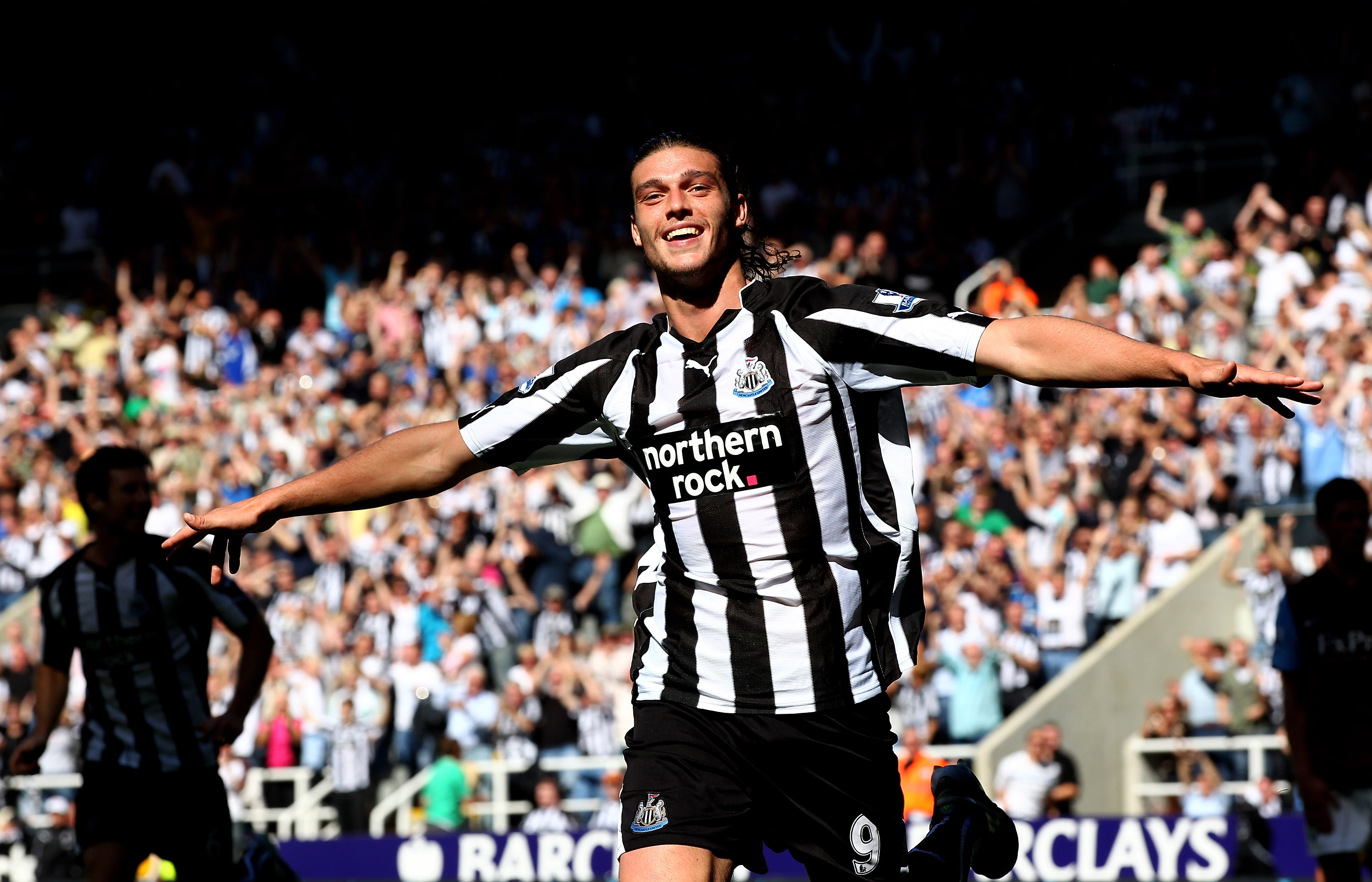 NEWCASTLE UPON TYNE, ENGLAND - AUGUST 22: Andy Carroll of Newcastle United celebrates scoring his teams fourth goal during the Barclays Premier League match between Newcastle United and Aston Villa at St James' Park on August 22, 2010 in Newcastle upon Ty