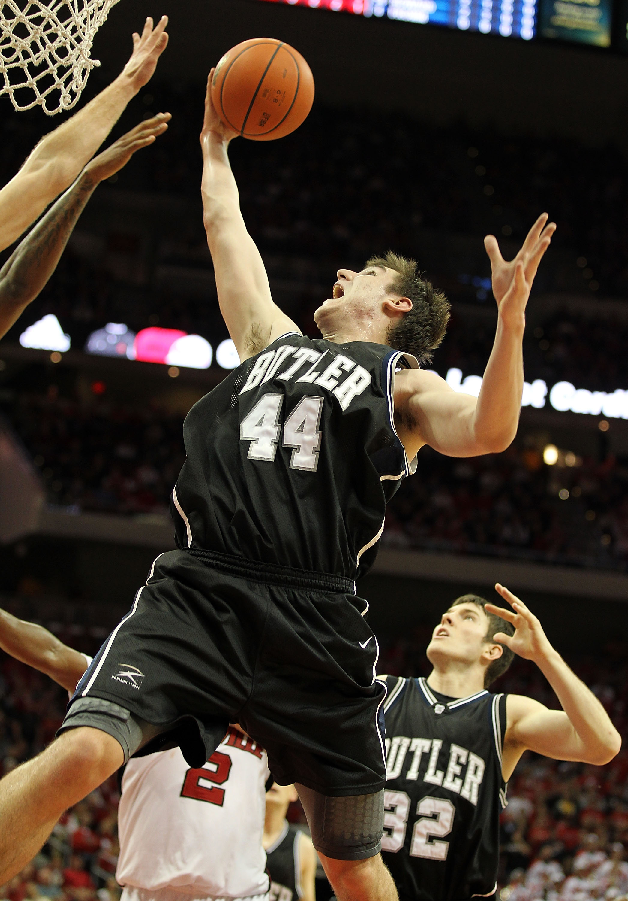 LOUISVILLE, KY - NOVEMBER 16: Matt Howard #54  of the Butler Bulldogs grabs a rebound during the game against the Louisville Cardinals at the KFC Yum! Center on November 16, 2010 in Louisville, Kentucky.  (Photo by Andy Lyons/Getty Images)