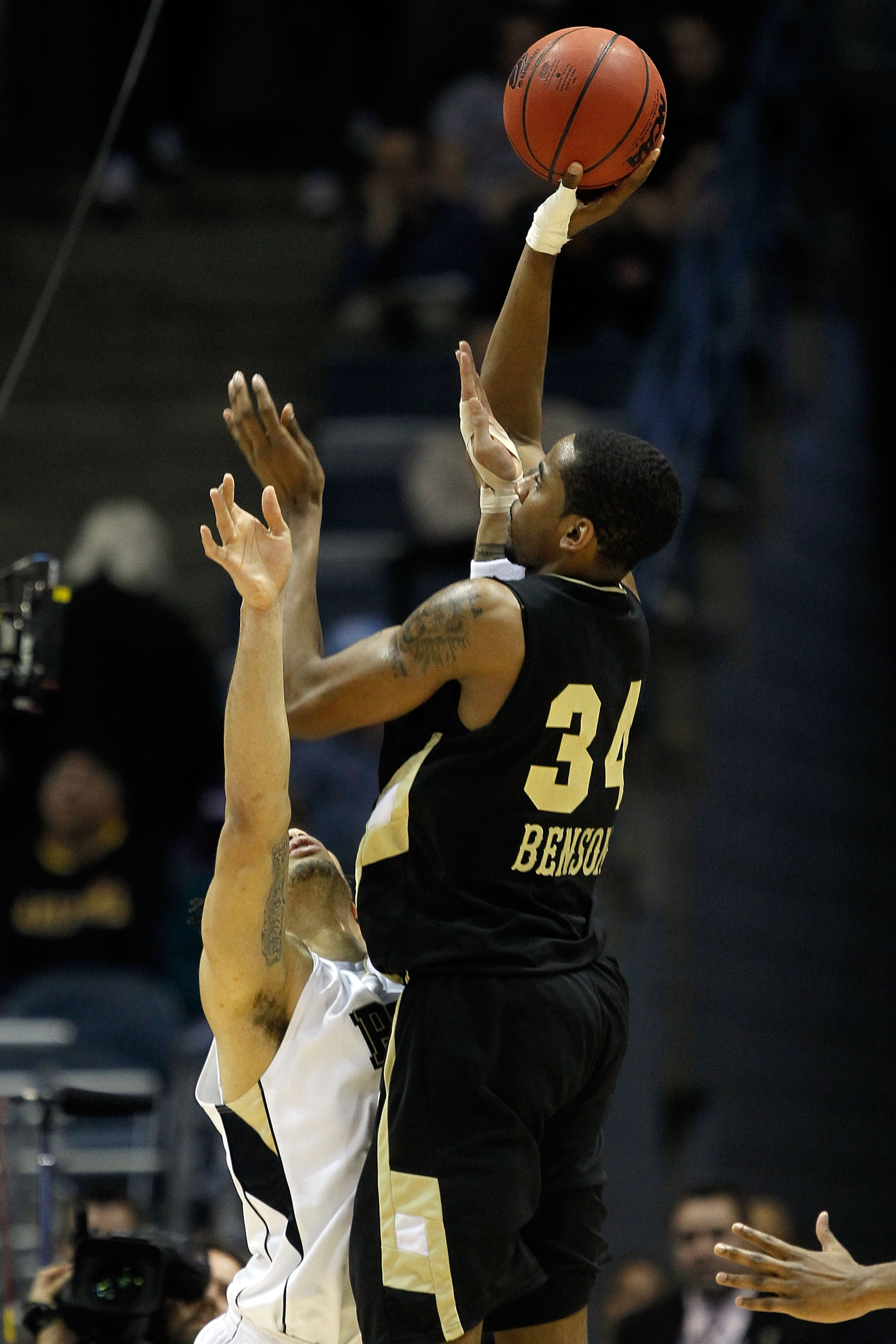 MILWAUKEE - MARCH 19:  Keith Benson #34 of the Oakland Golden Grizzlies shoots the ball over Gary McGhee #52 of the Pittsburgh Panthers in the second half during the first round of the 2010 NCAA men's basketball tournament at the Bradley Center on March 1