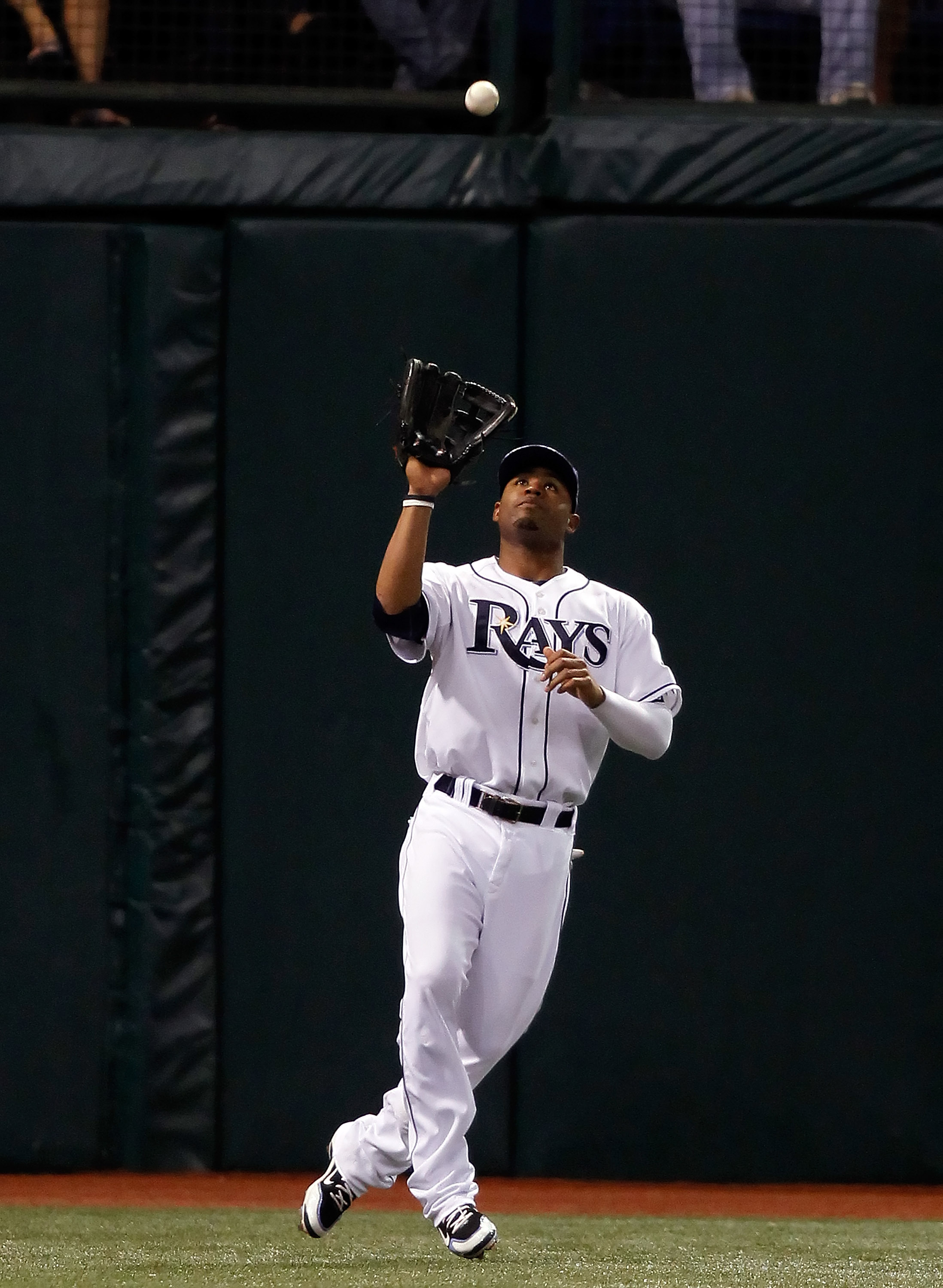 ST. PETERSBURG, FL - SEPTEMBER 29:  Outfielder Carl Crawford #13 of the Tampa Bay Rays catches a fly ball against the Baltimore Orioles during the game at Tropicana Field on September 29, 2010 in St. Petersburg, Florida.  (Photo by J. Meric/Getty Images)