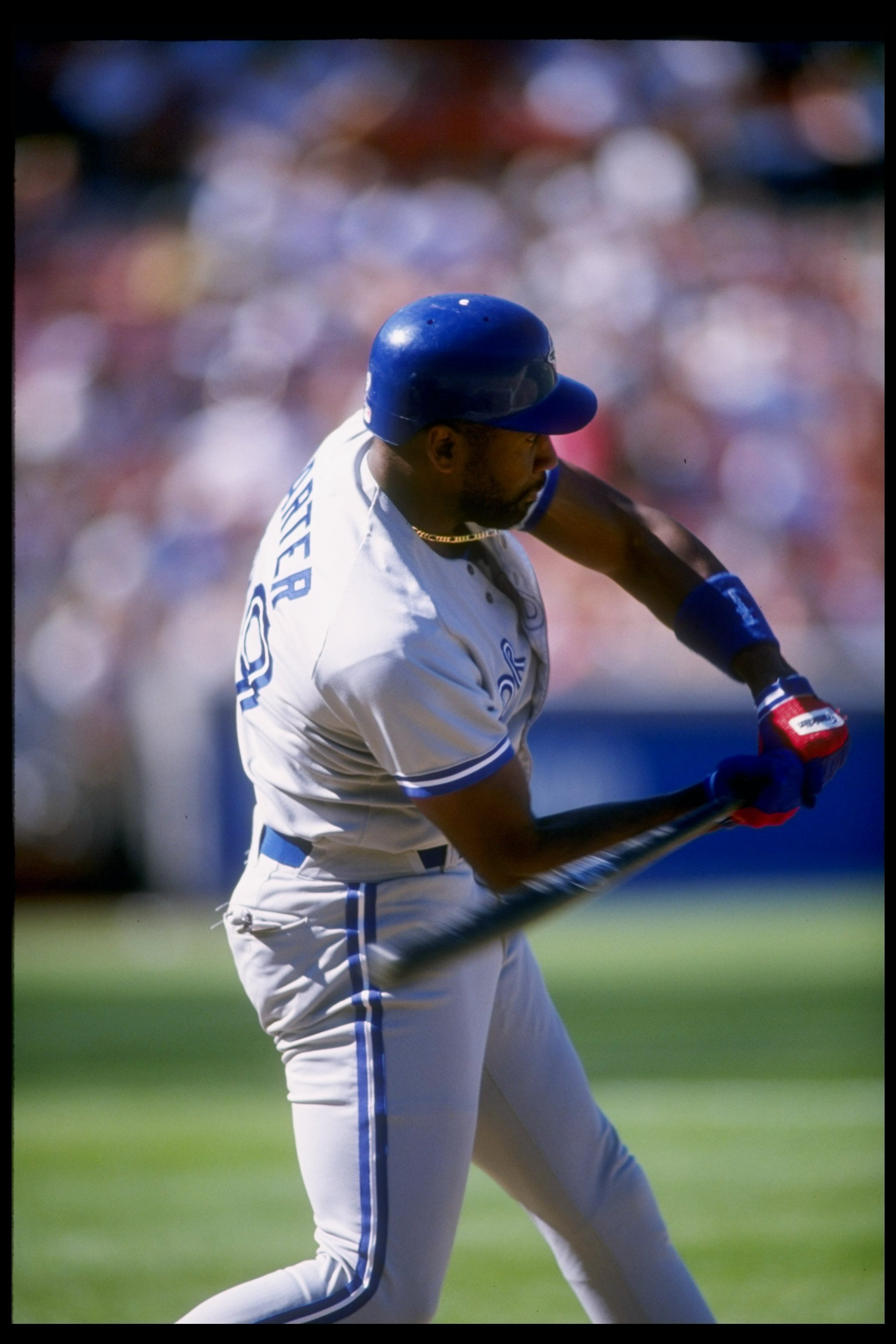8 Jul 1995:  First baseman Joe Carter of the Toronto Blue Jays swings at the ball during a game against the Oakland Athletics at the Oakland Coliseum in Oakland, California.  The Blue Jays won the game 9-6. Mandatory Credit: Jed Jacobsohn  /Allsport