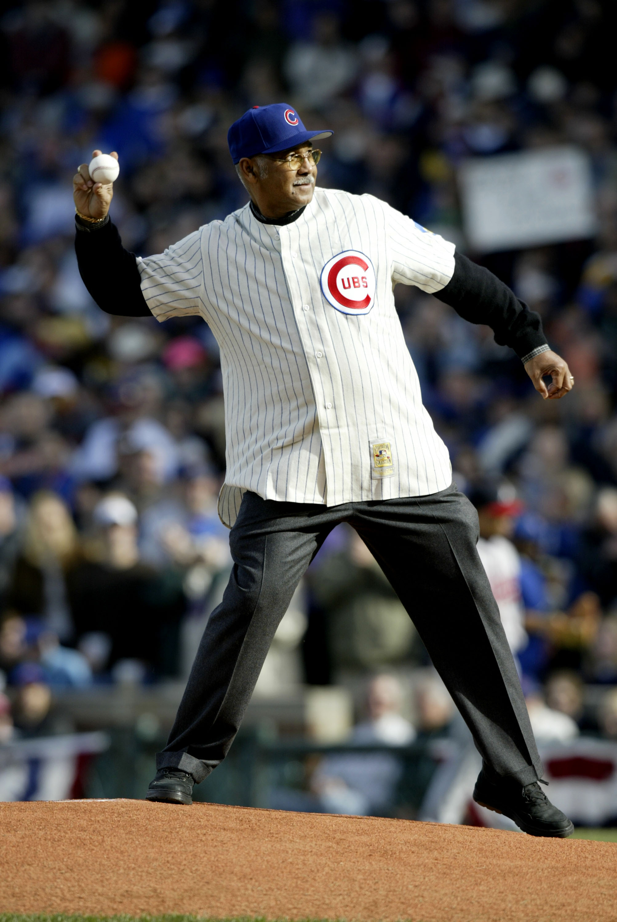 CHICAGO - OCTOBER 4:  Former Cub Billy Williams throws out the ceremonial first pitch before the Chicago Cubs take on the Atlanta Braves during game four of their National League Division Series October 4, 2003 at Wrigley Field in Chicago, Illinois.  (Pho
