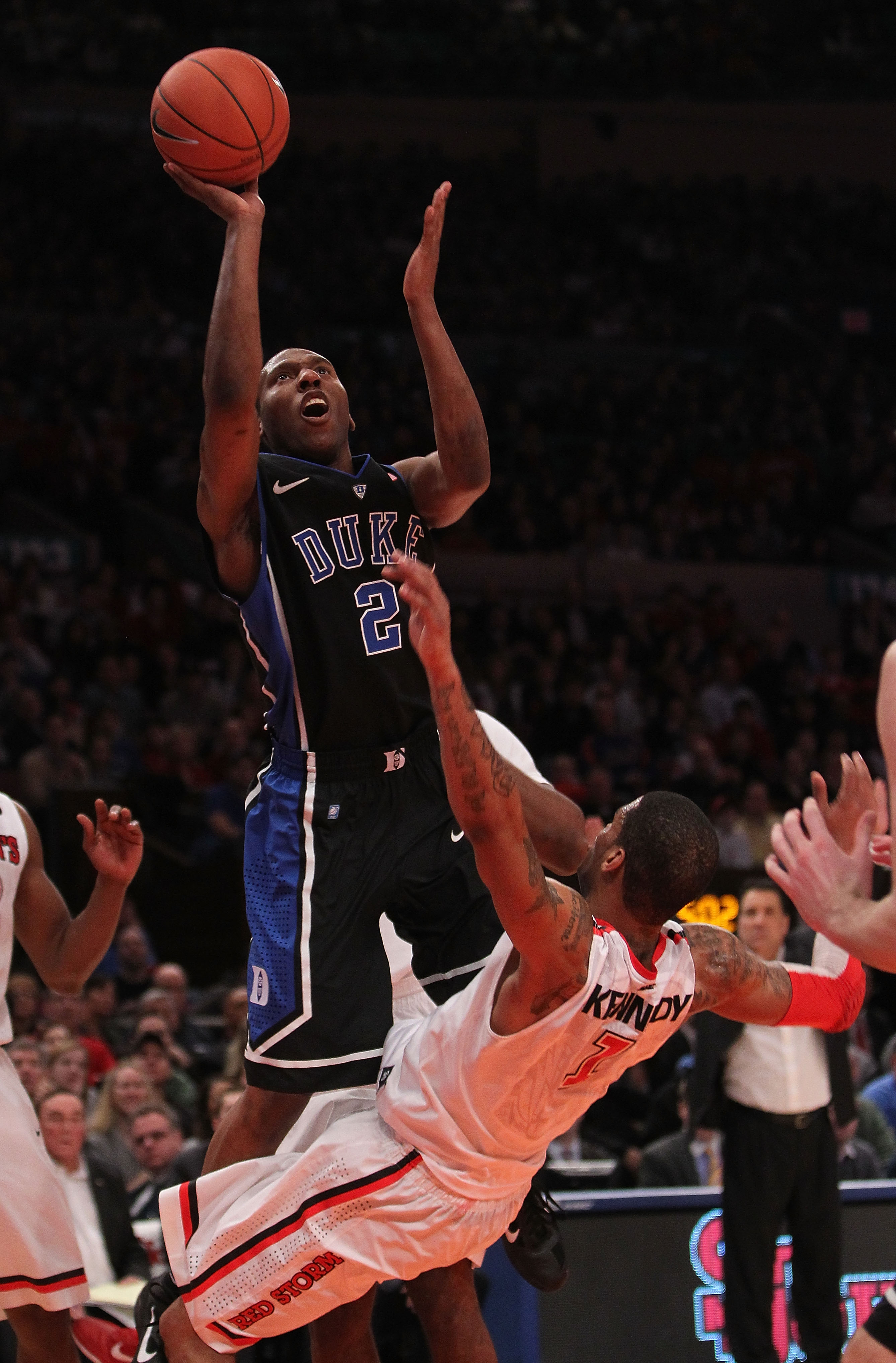 NEW YORK, NY - JANUARY 30:  Nolan Smith #2 of the Duke Blue Devils shoots the ball over D.J. Kennedy #1 of the St. John's Red Storm at Madison Square Garden on January 30, 2011 in New York City.  (Photo by Nick Laham/Getty Images)