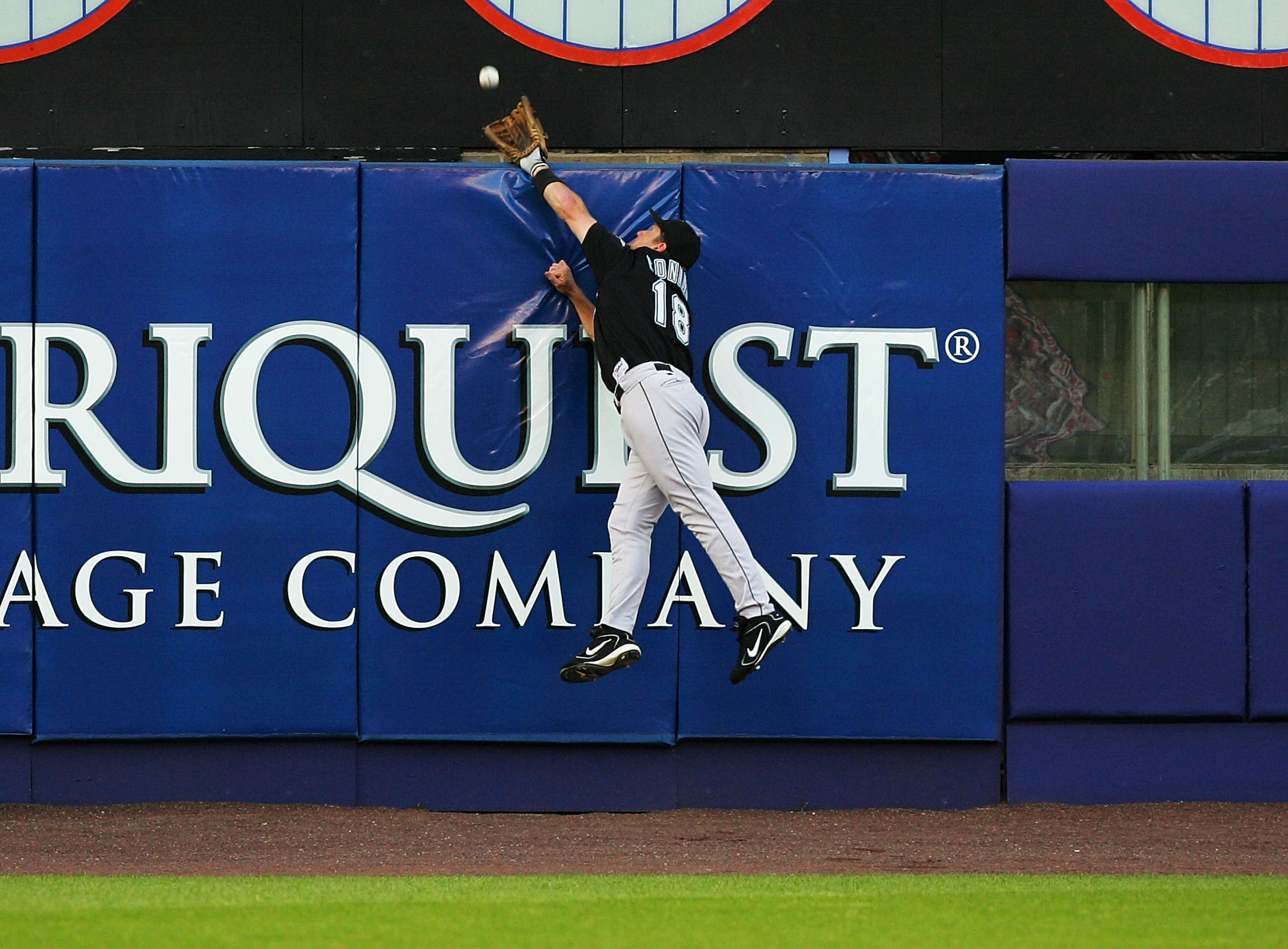 NEW YORK - JULY 19:  Jeff Conine #18 of the Florida Marlins leaps but can not catch a three-run home run hit by Shane Spencer #43 of the New York Mets on July 19, 2004, at Shea Stadium in Flushing, New York.  (Photo by Ezra Shaw/Getty Images)