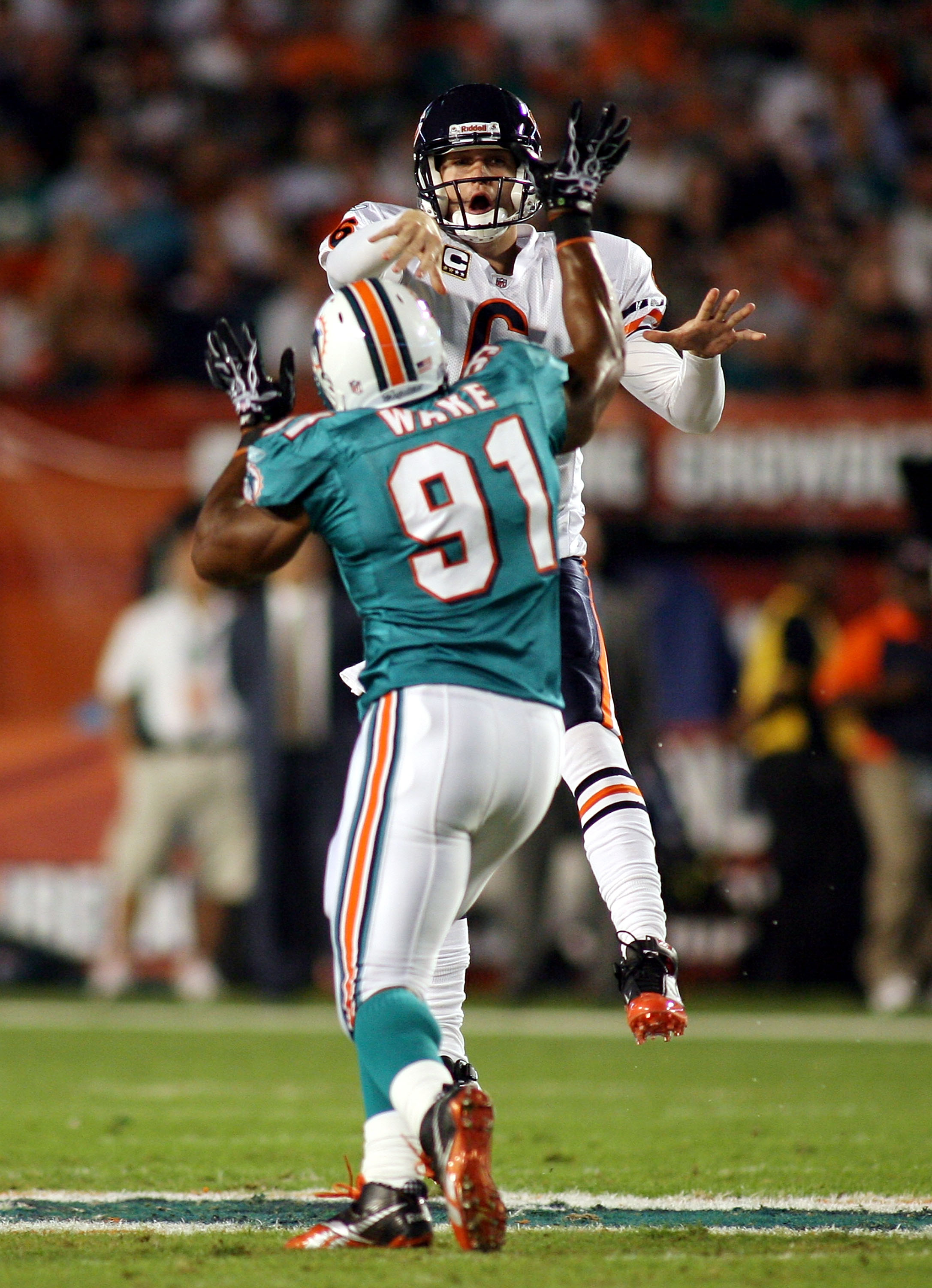MIAMI - NOVEMBER 18:  Quarterback Jay Cutler #6 of the Chicago Bears is preasured by linebacker Cameron wake #91 of the Miami Dolphins at Sun Life Stadium on November 18, 2010 in Miami, Florida.  (Photo by Marc Serota/Getty Images)