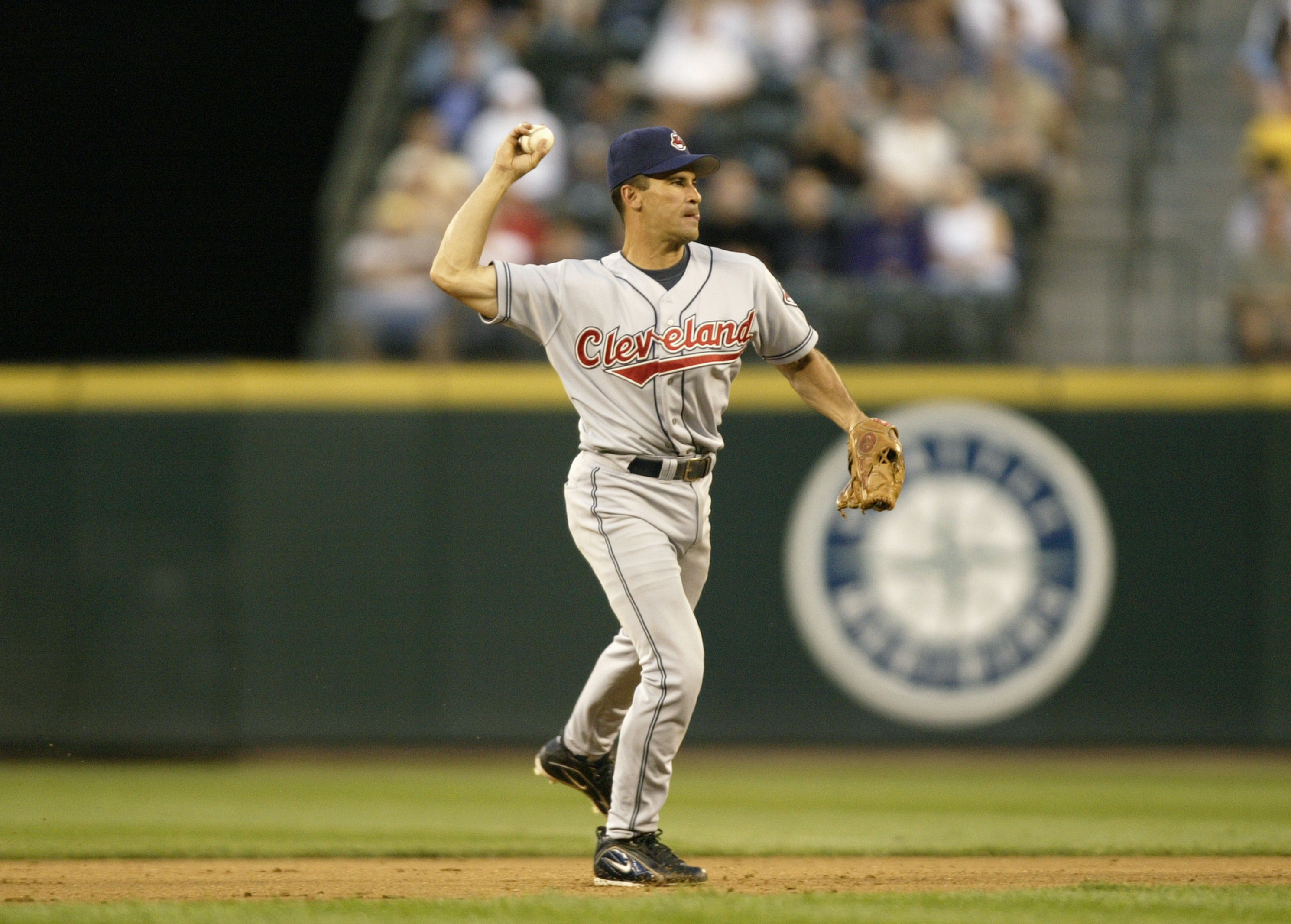 SEATTLE - JULY 15:  Omar Vizquel#13 of the Cleveland Indians throws the ball during the game against the Seattle Mariners on July 15, 2004 at Safeco Field in Seattle, Washington.  The Mariners defeated the Indians 2-1.  (Photo by Otto Greule Jr/Getty Imag