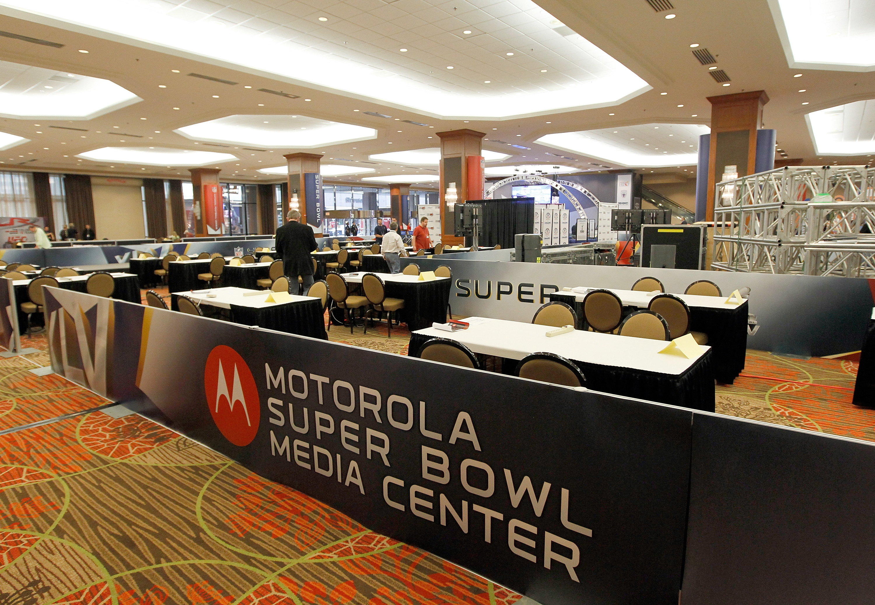 DALLAS, TX - JANUARY 30:  Members of the working media arrive for the opening day of the Motorola Super Bowl XLV Media Center on January 30, 2011 in Dallas, Texas.  Cowboys Stadium will host Super Bowl XLV on February 6, 2011 between the Pittsburgh Steele