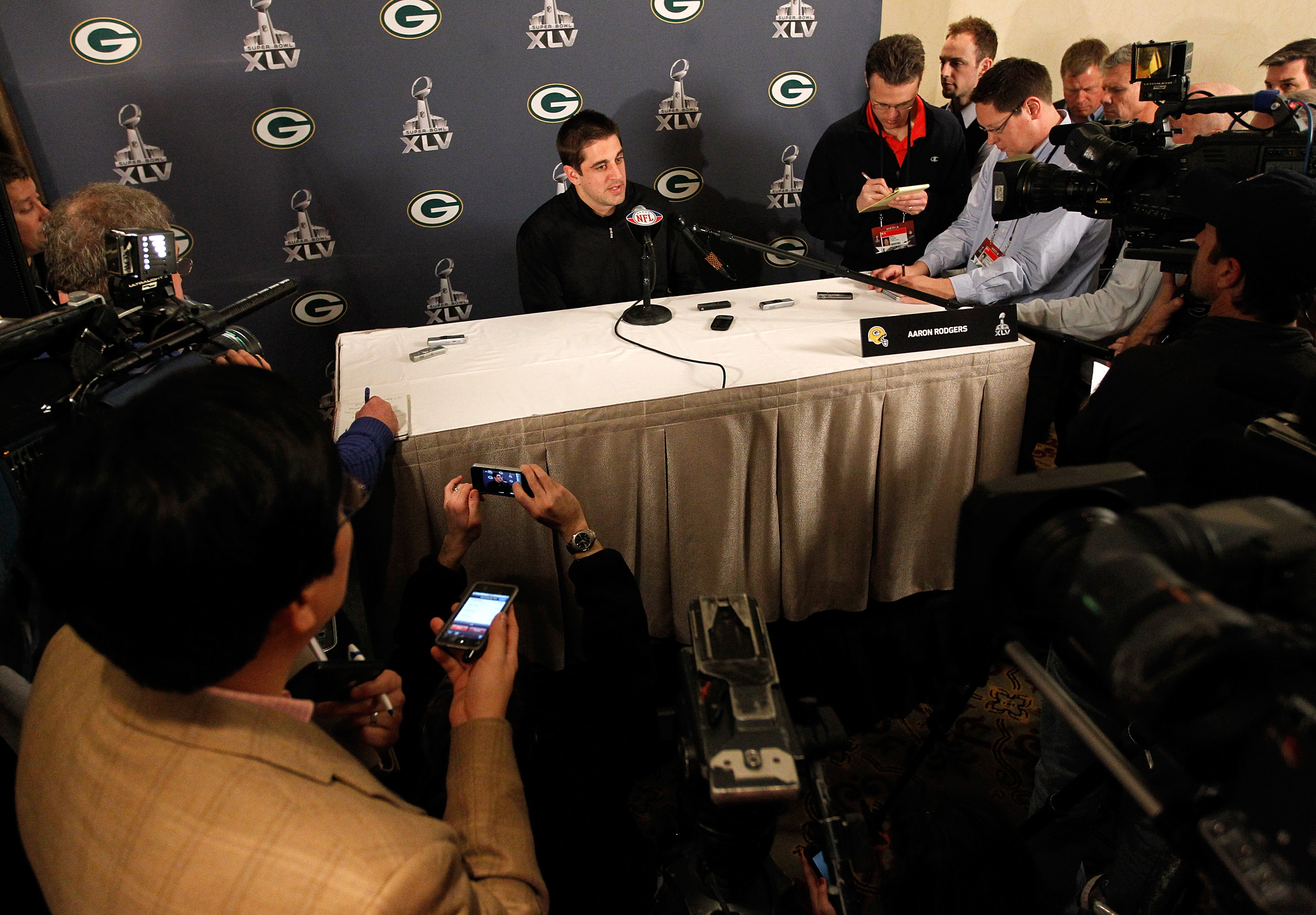 IRVING, TX - JANUARY 31:  Quarterback Aaron Rodgers #12 of the Green Bay Packers talks to the media on January 31, 2011 in Irving, Texas. The Green Bay Packers will play the Pittsburgh Steelers in Super Bowl XLV on February 6, 2011 at Cowboys Stadium in A