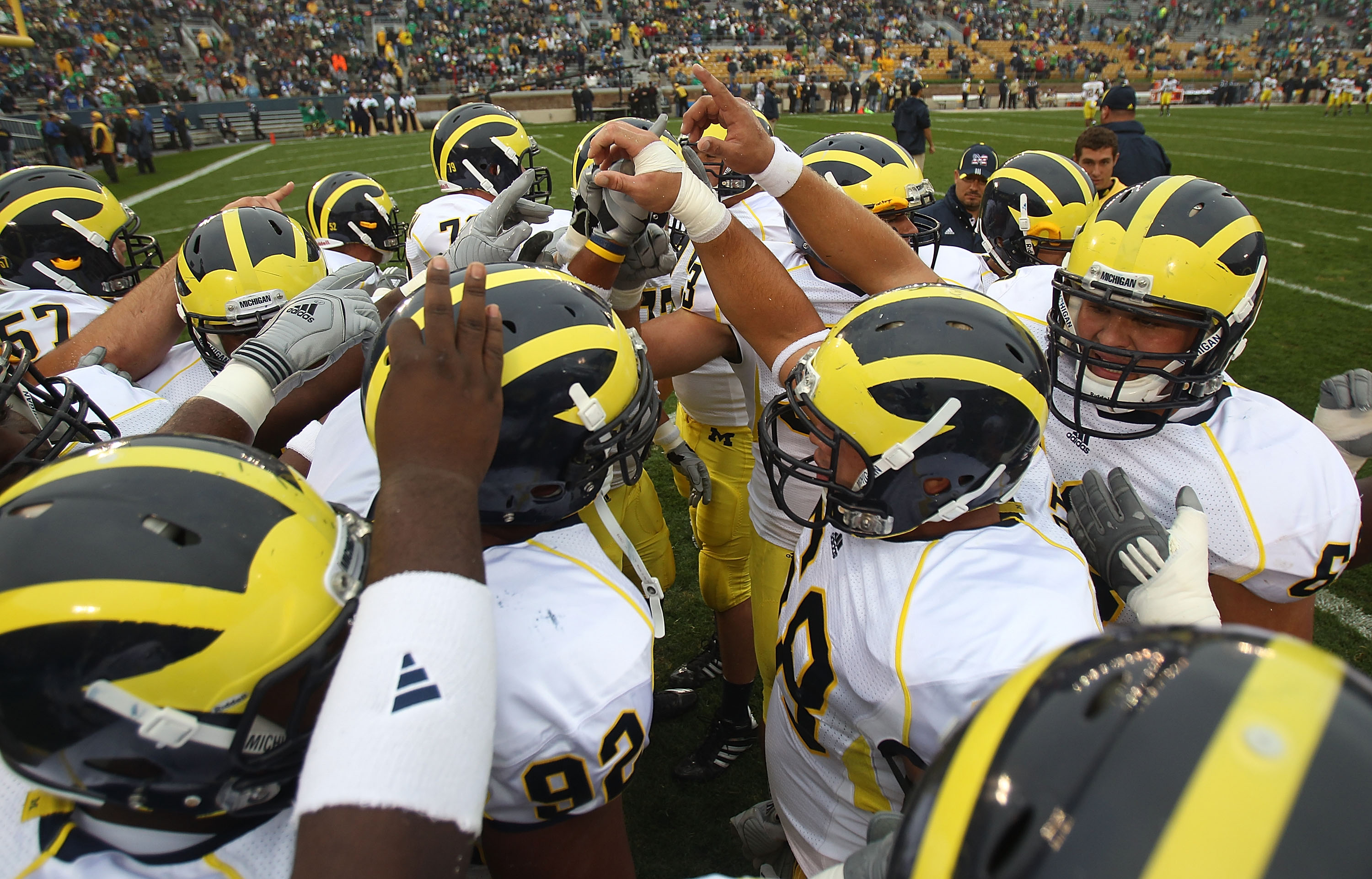 SOUTH BEND, IN - SEPTEMBER 11: Members of the Michigan Wolverines get ready during warm-ups to play against the Notre Dame Fighting Irish at Notre Dame Stadium on September 11, 2010 in South Bend, Indiana. Michigan defeated Notre Dame 28-24.  (Photo by Jo