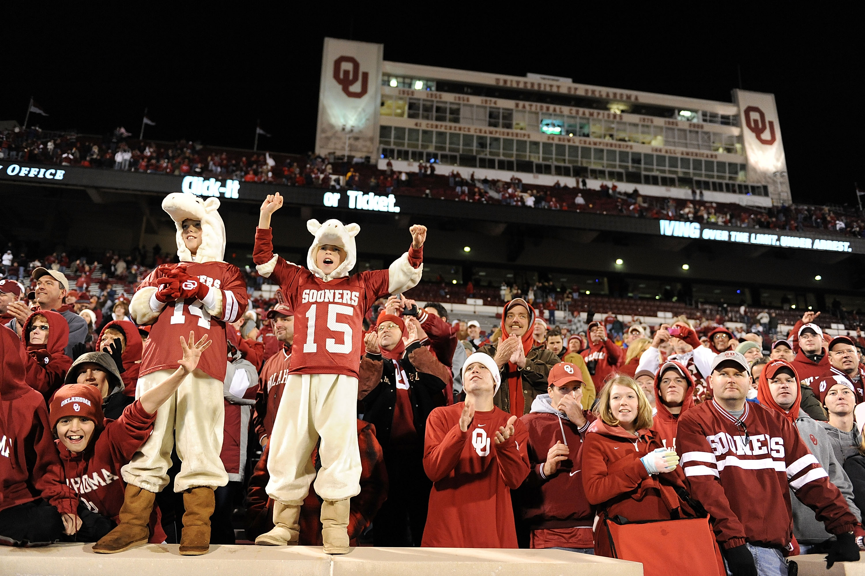 NORMAN, OK - NOVEMBER 22:  Fans of the Oklahoma Sooners celebrate a 65-21 win against the Texas Tech Red Raiders at Memorial Stadium on November 22, 2008 in Norman, Oklahoma.  (Photo by Ronald Martinez/Getty Images)