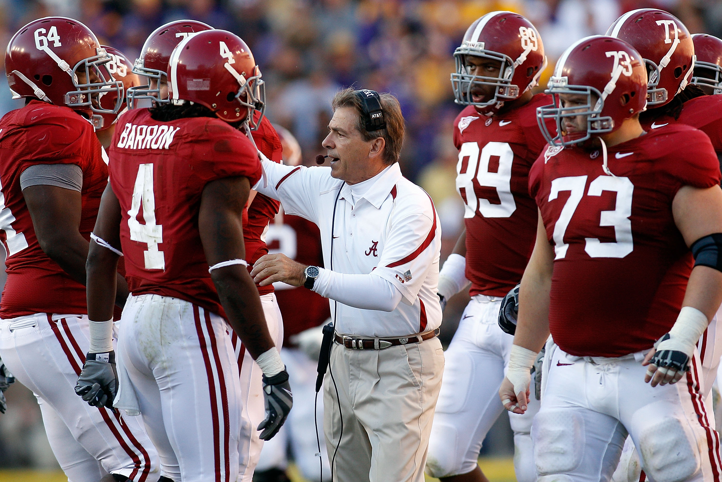 BATON ROUGE, LA - NOVEMBER 06:  Head coach Nick Saban of the Alabama Crimson Tide talks with his team during the game against the Louisiana State University Tigers at Tiger Stadium on November 6, 2010 in Baton Rouge, Louisiana. The Tigers defeated the Cri
