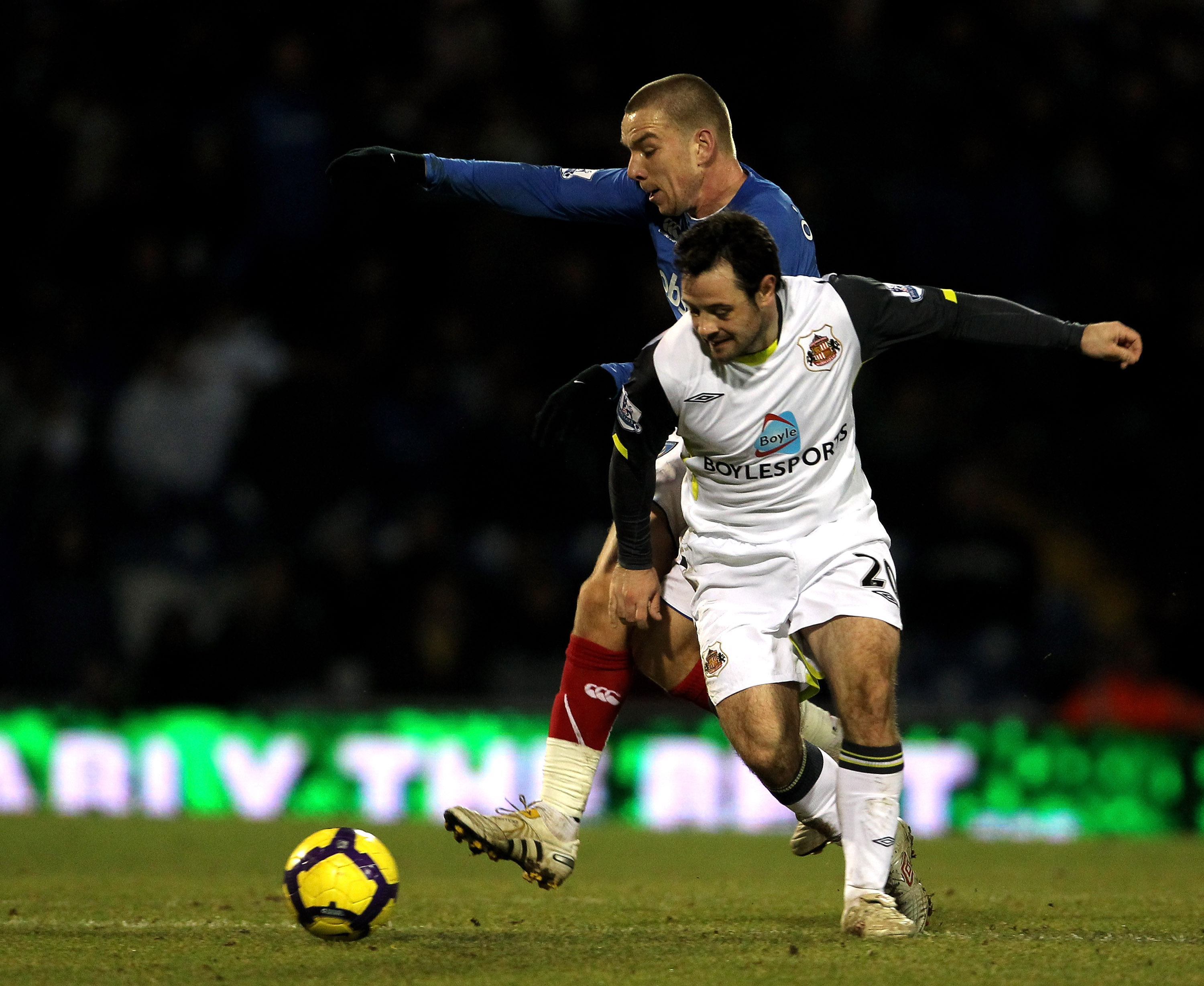 PORTSMOUTH, ENGLAND - FEBRUARY 09: Jamie O'Hara of Portsmouth gets tackled by Andy Reid of Sunderland during the Barclays Premier League match between Portsmouth and Sunderland at Fratton Park on February 9, 2010 in Portsmouth, England.  (Photo by Phil Co