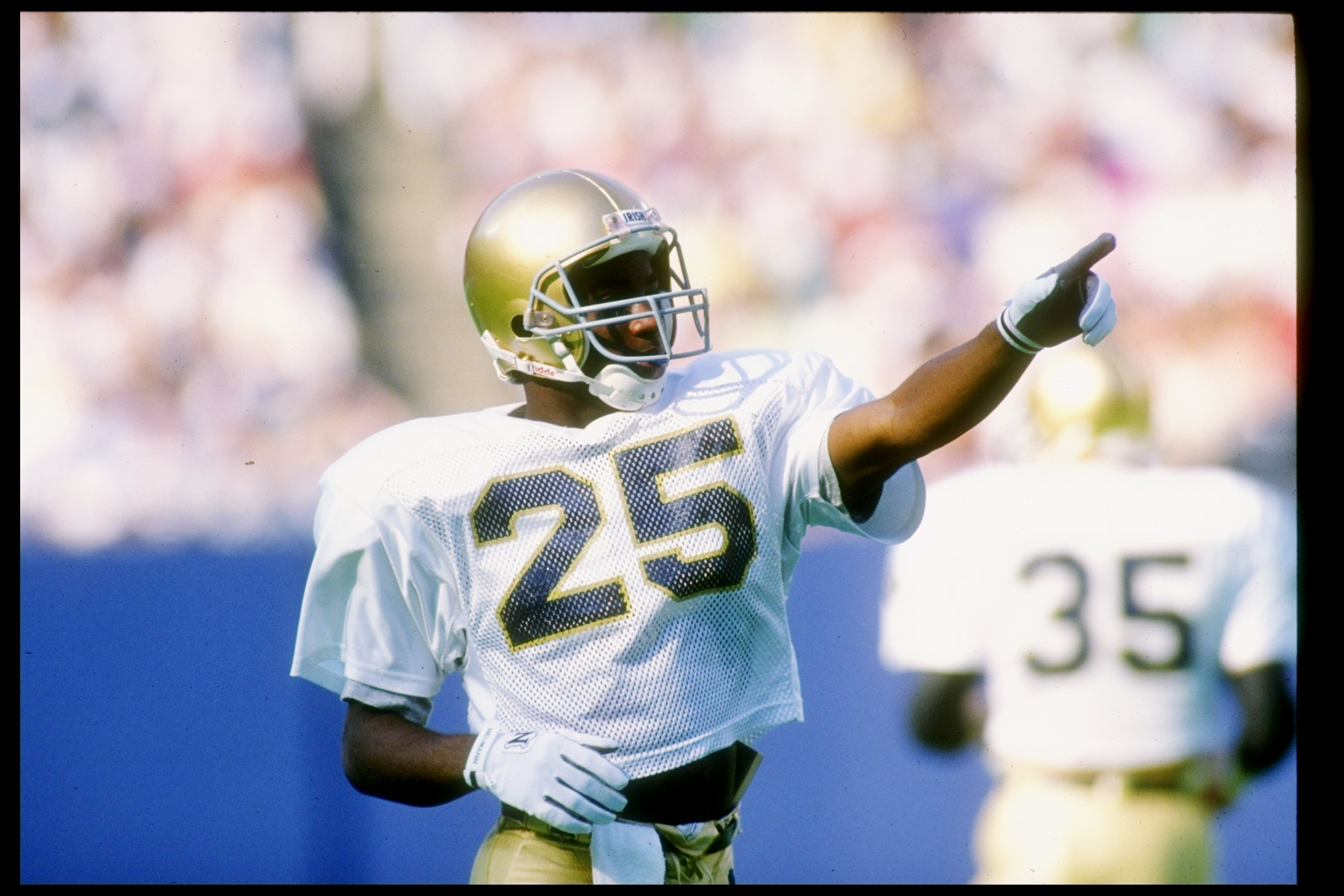 3 Nov 1990:  Flanker Raghib Ismail of the Notre Dame Fighting Irish points to the crowd during a game against the Navy Midshipman at Giants Stadium in East Rutherford, New Jersey.  Notre Dame won the game 52-31. Mandatory Credit: Rick Stewart  /Allsport