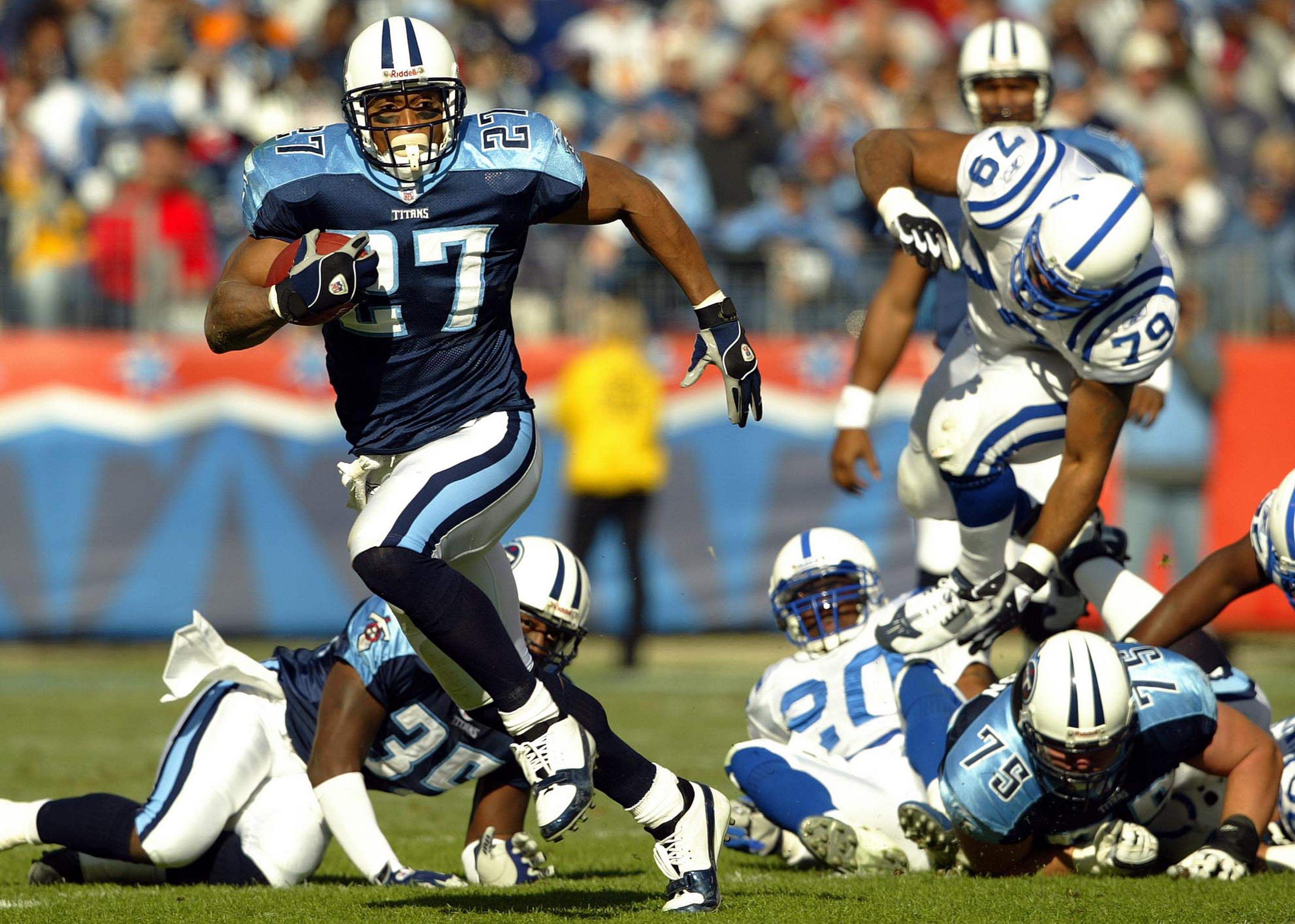 NASHVILLE,TN - DECEMBER 7:  Eddie George #27 of the Tennessee Titans runs with the ball against the Indianapolis Colts during the Colts 29-27 victory  on December 7, 2003 at The Coliseum in Nashville, Tennessee.  (Photo by Andy Lyons/Getty Images)