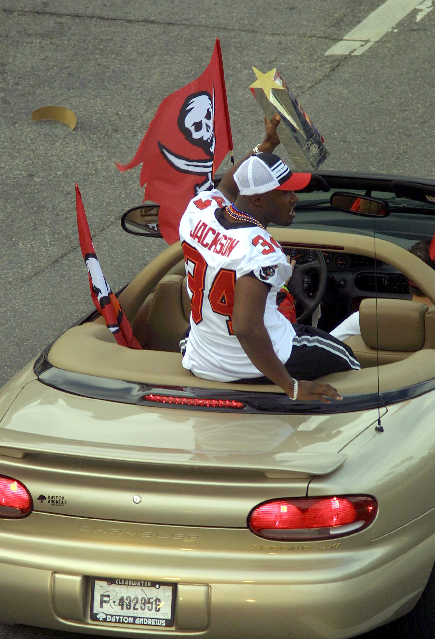 TAMPA, FL - JANUARY 28:  Dexter Jackson of the Tampa Bay Buccaneers shows off his Super Bowl MVP trophy during a victory parade on January 28, 2003 in Tampa, Florida. The Buccaneers defeated the Oakland Raiders 48-21 in Super Bowl XXXVII. (Photo by Chris