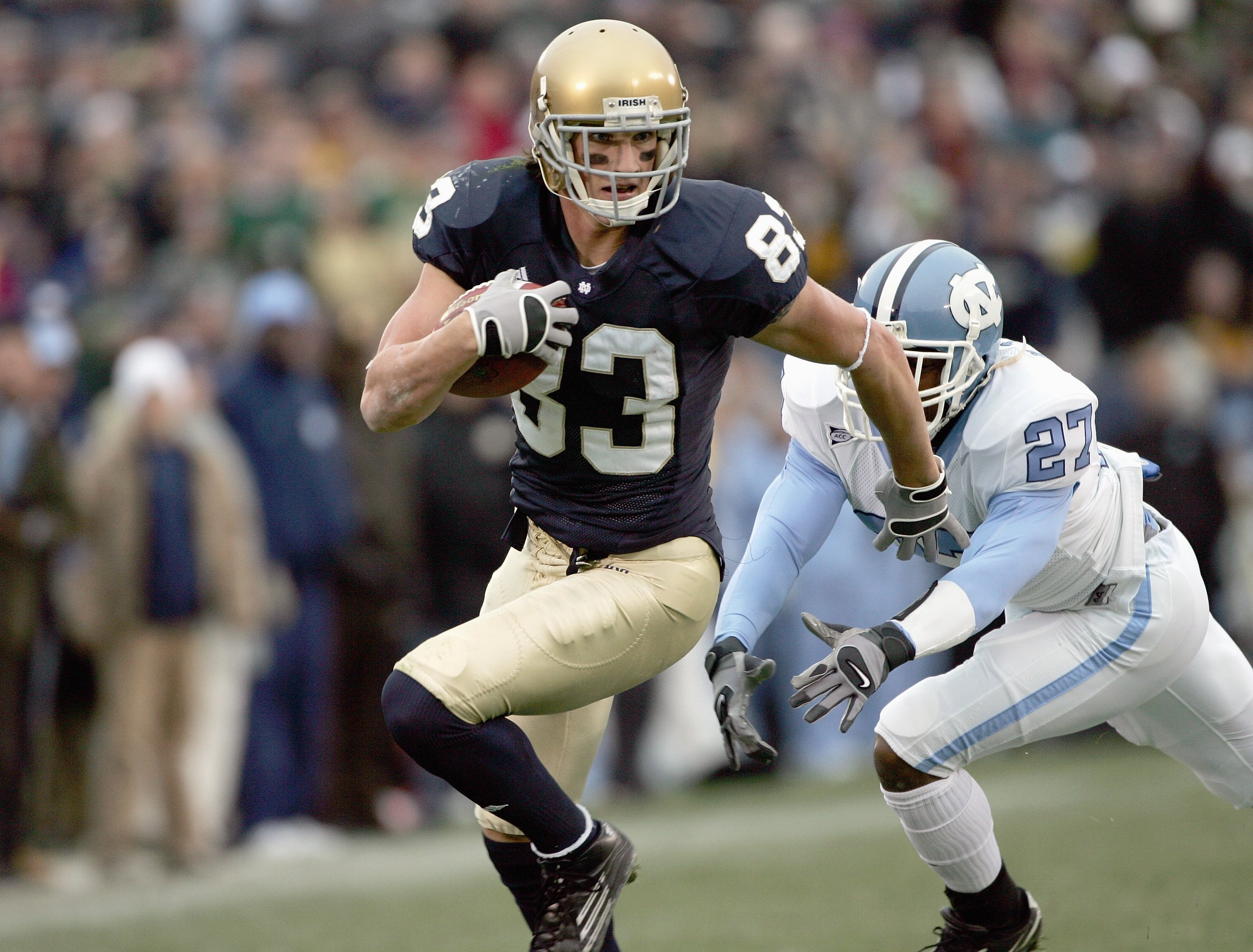SOUTH BEND, IN - NOVEMBER 4:  Jeff Samardzija #83 of the Notre Dame Fighting Irish carries the ball during the game against the North Carolina Tar Heels on November 4, 2006 at Notre Dame Stadium in South Bend, Indiana. (Photo by Jonathan Daniel/Getty Imag