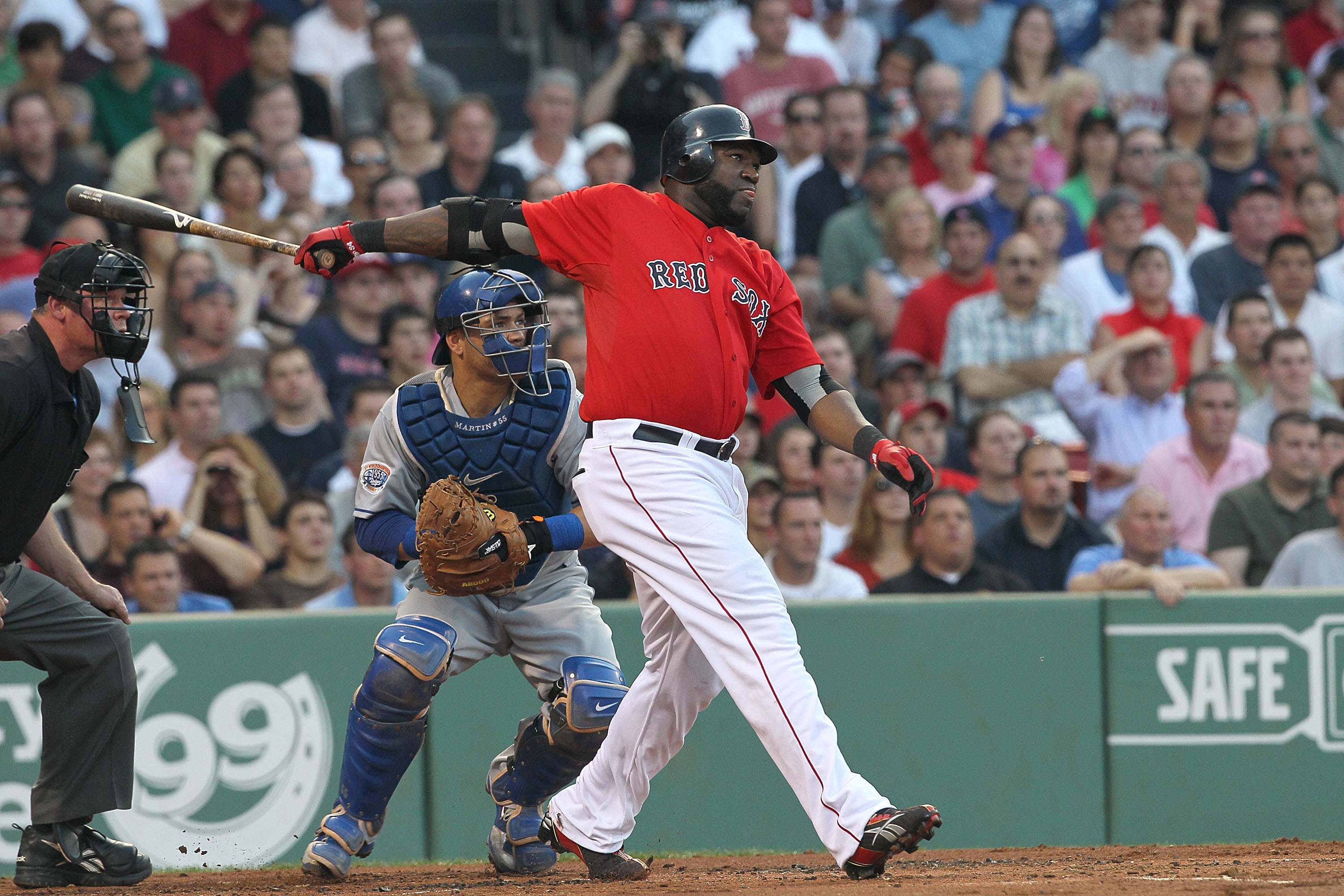 BOSTON - JUNE 18:  David Ortiz of the Boston Red Sox hits a home run against the Los Angeles Dodgers at Fenway Park on June 18, 2010 in Boston, Massachusetts. (Photo by Jim Rogash/Getty Images)