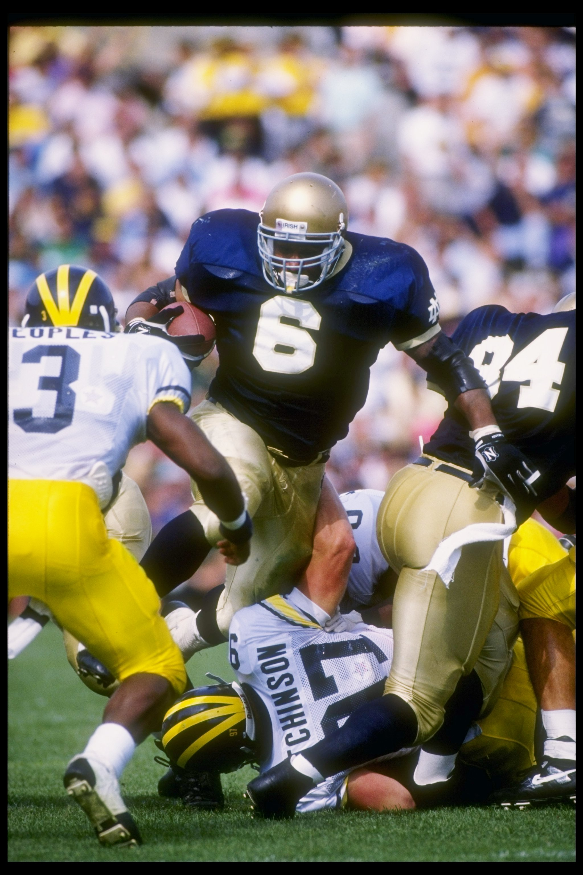 12 Sep 1992:  Fullback Jerome Bettis of the Notre Dame Fighting Irish tries to break through the Michigan Wolverines line during a game at Notre Dame Stadium in South Bend, Indiana.  Notre Dame won the game 17-17. Mandatory Credit: Jonathan Daniel  /Allsp