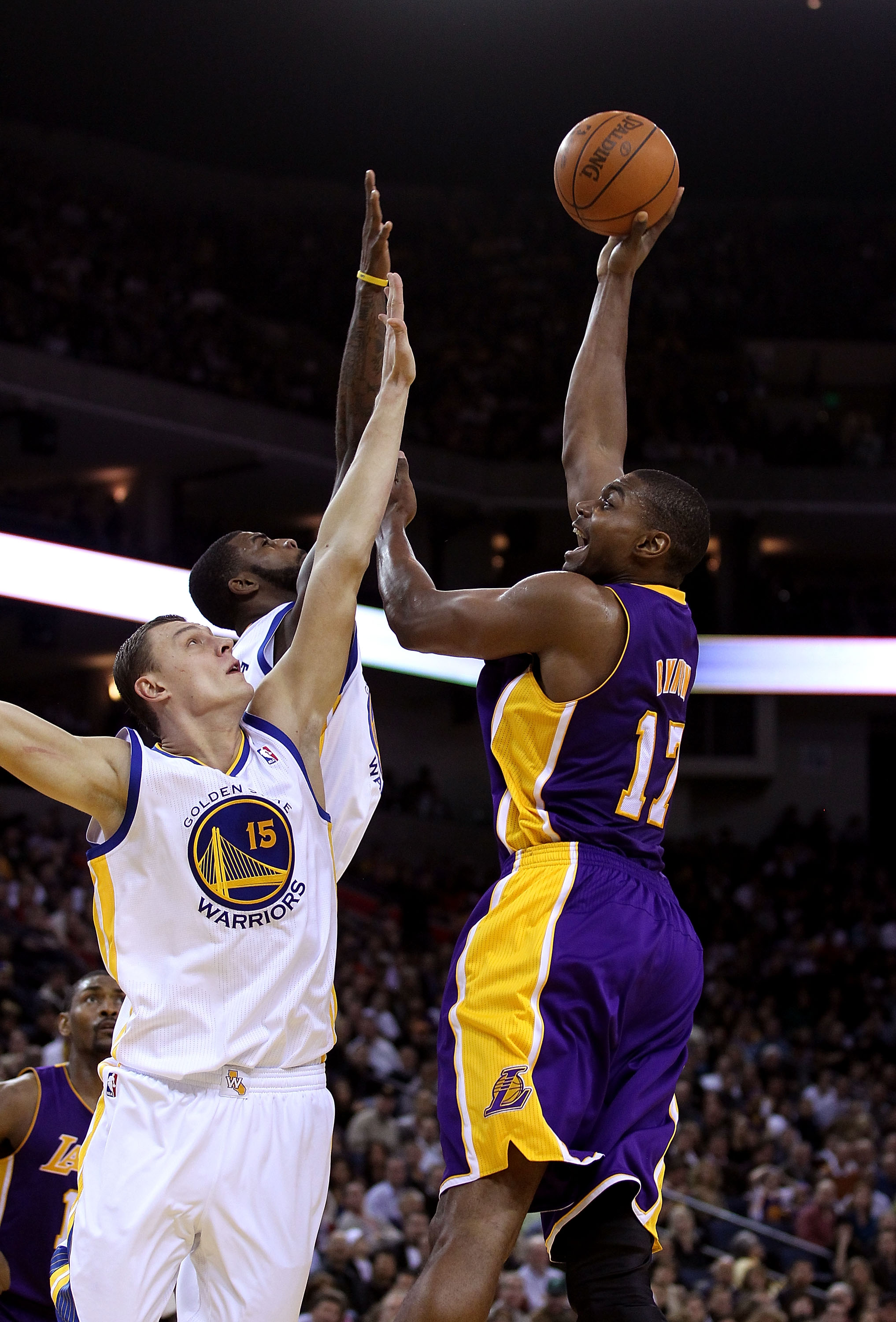 OAKLAND, CA - JANUARY 12: Andrew Bynum #17 of the Los Angeles Lakers shoots over Andris Biedrins #15 of the Golden State Warriors at Oracle Arena on January 12, 2011 in Oakland, California. NOTE TO USER: User expressly acknowledges and agrees that, by dow