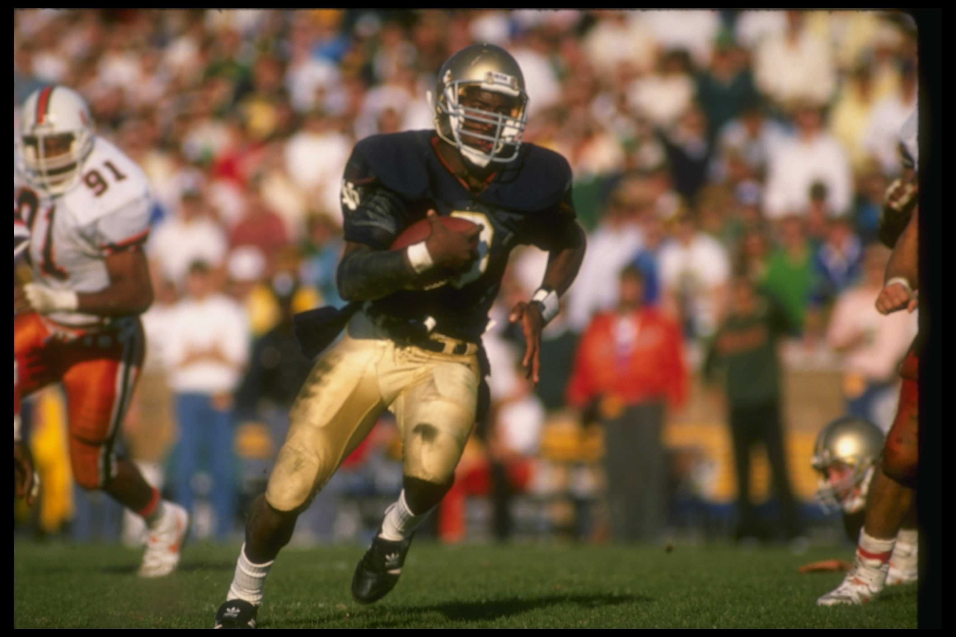 15 Oct 1988:  Tony Rice of the Notre Dame Fighting Irish runs with the ball during a game against the Miami Hurricanes at Notre Dame Stadium in South Bend, Indiana.  Notre Dame won the game, 31-30. Mandatory Credit: Jonathan Daniel  /Allsport