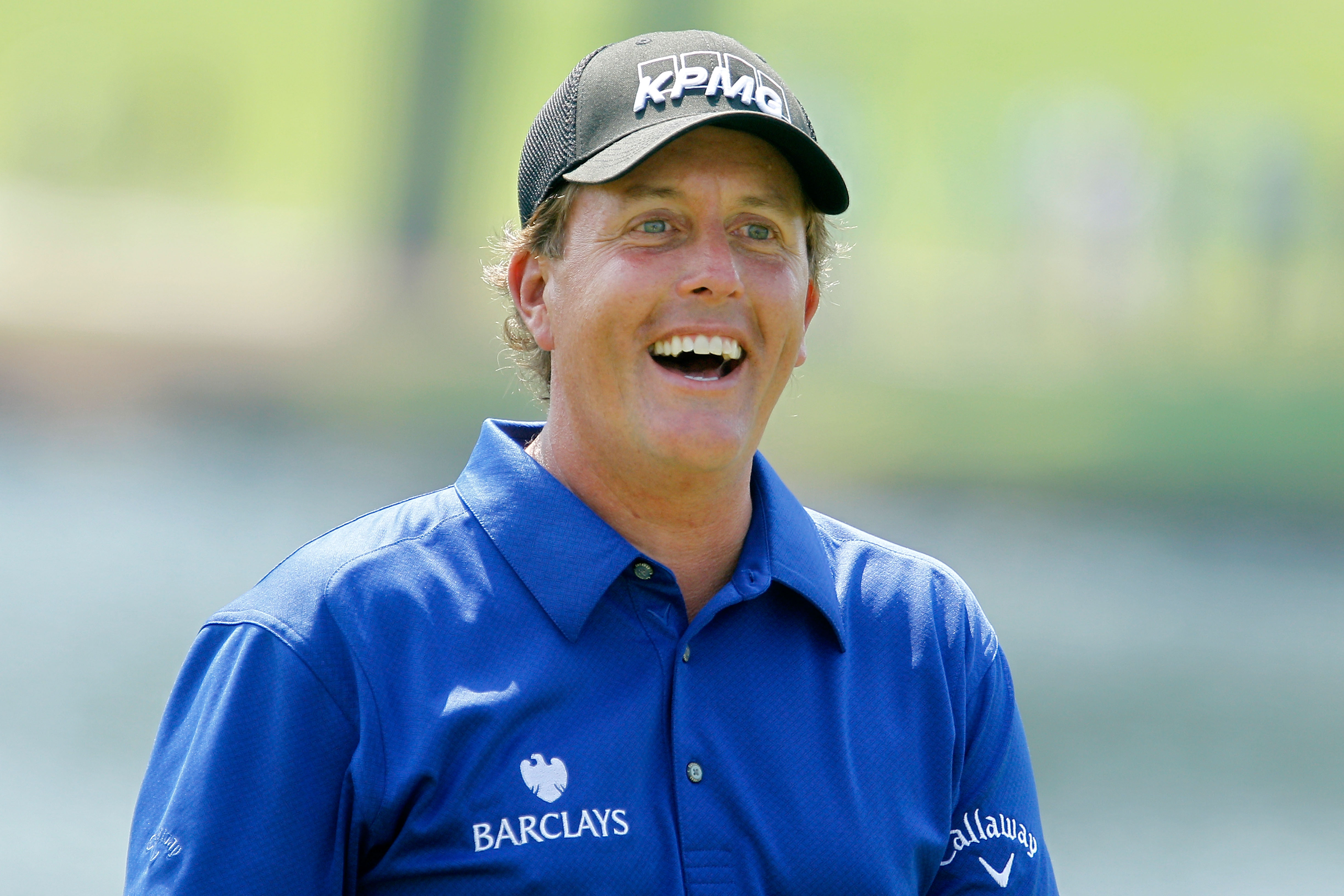 ATLANTA - SEPTEMBER 23:  Phil Mickelson smiles while on the practice range prior to playing his first round of THE TOUR Championship presented by Coca-Cola at East Lake Golf Club on September 23, 2010 in Atlanta, Georgia.  (Photo by Scott Halleran/Getty I