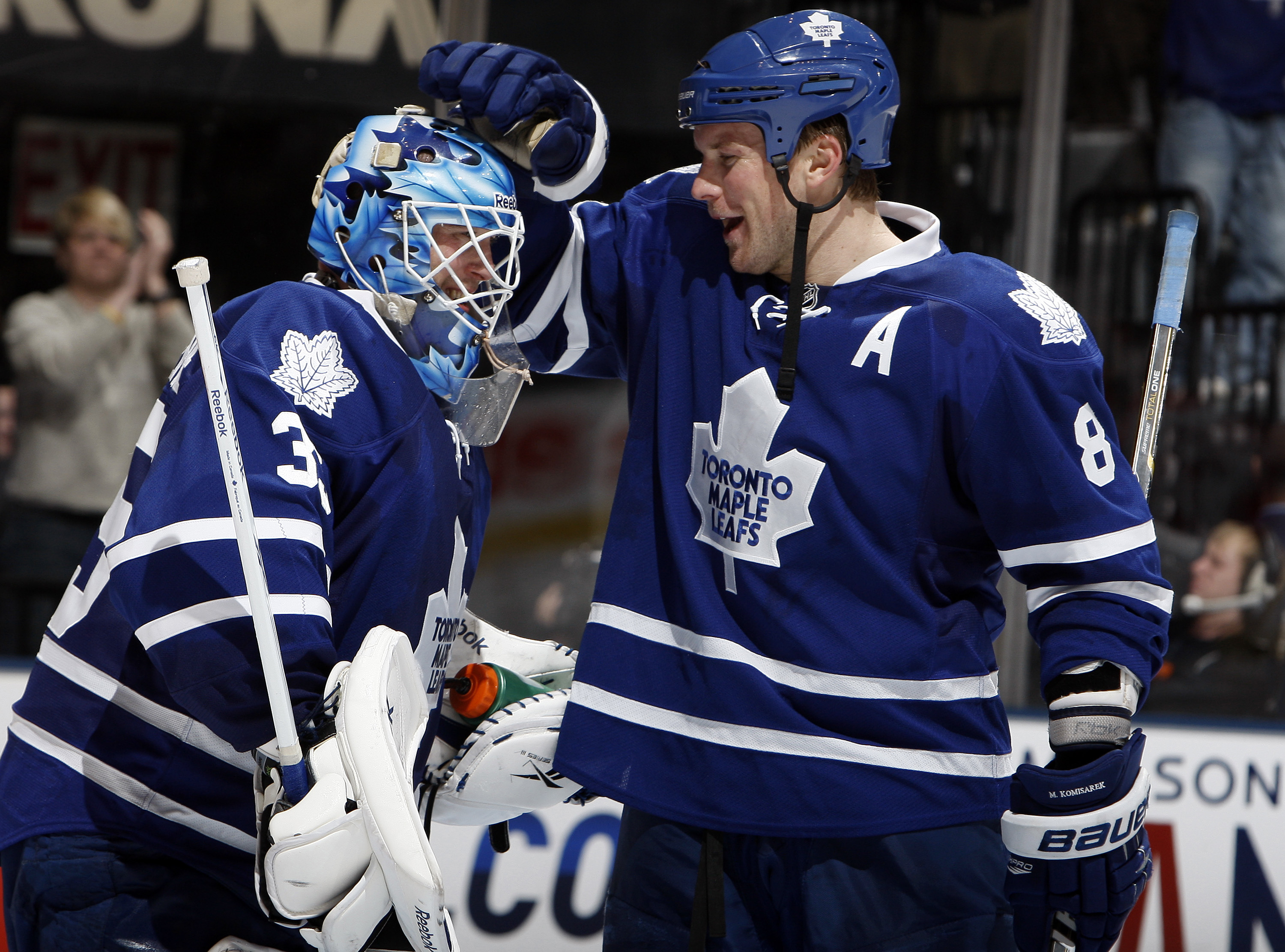 TORONTO, CANADA - FEBRUARY 1:  Jean-Sebastien Giguere #35 and Mike Komisarek #8 of the Toronto Maple Leafs celebrate after stopping Christopher Higgins of the Florida Panthers to win the shootout at the Air Canada Centre February 1, 2011 in Toronto, Ontar