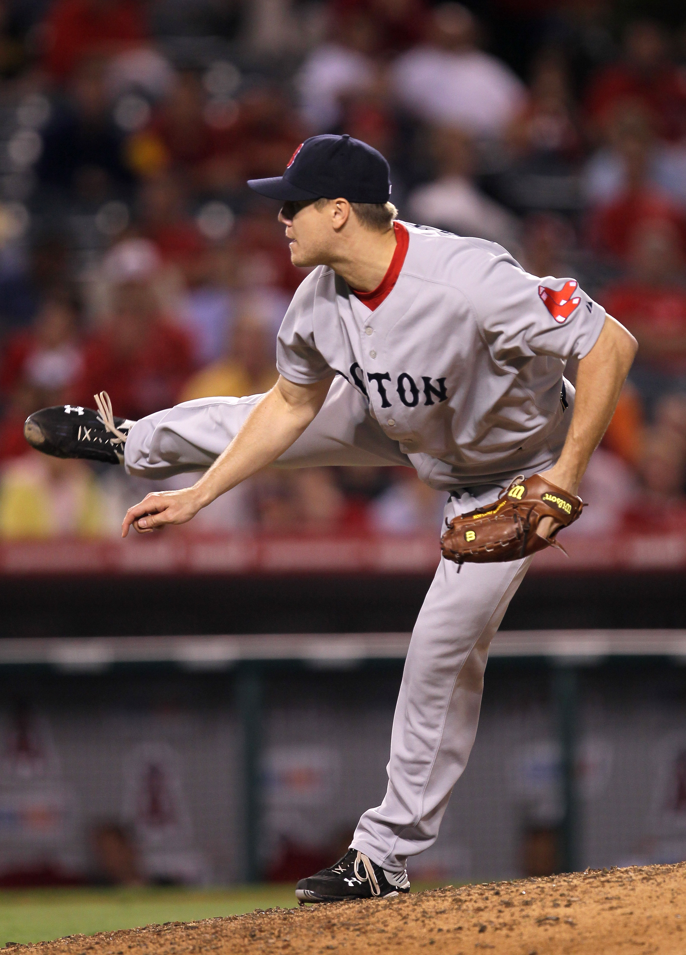 ANAHEIM, CA - JULY 27:  Closer Jonathan Paplebon #58 of the Boston Red Sox delivers a pitch on his way to picking up the save against the Los Angeles Angels of Anaheim on July 27, 2010 at Angel Stadium in Anaheim, California. The Red Sox won 4-2.  (Photo