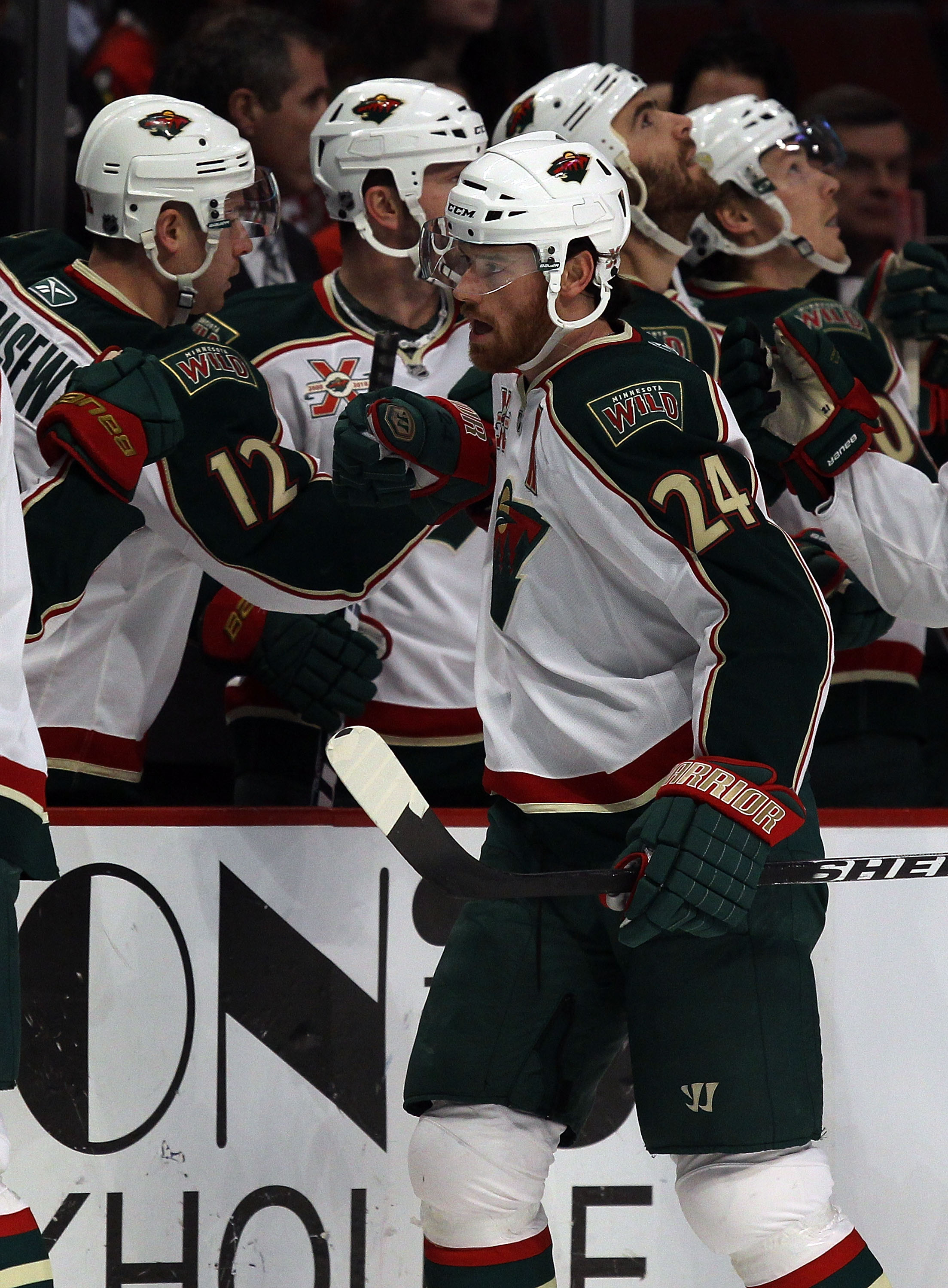 CHICAGO, IL - JANUARY 25: Martin Havlat #24 of the Minnesota Wild is congratulated by teammates after scoring a 1st period goal against the Chicago Blackhawks at the United Center on January 25, 2011 in Chicago, Illinois. The Wild defeated the Blackhawks
