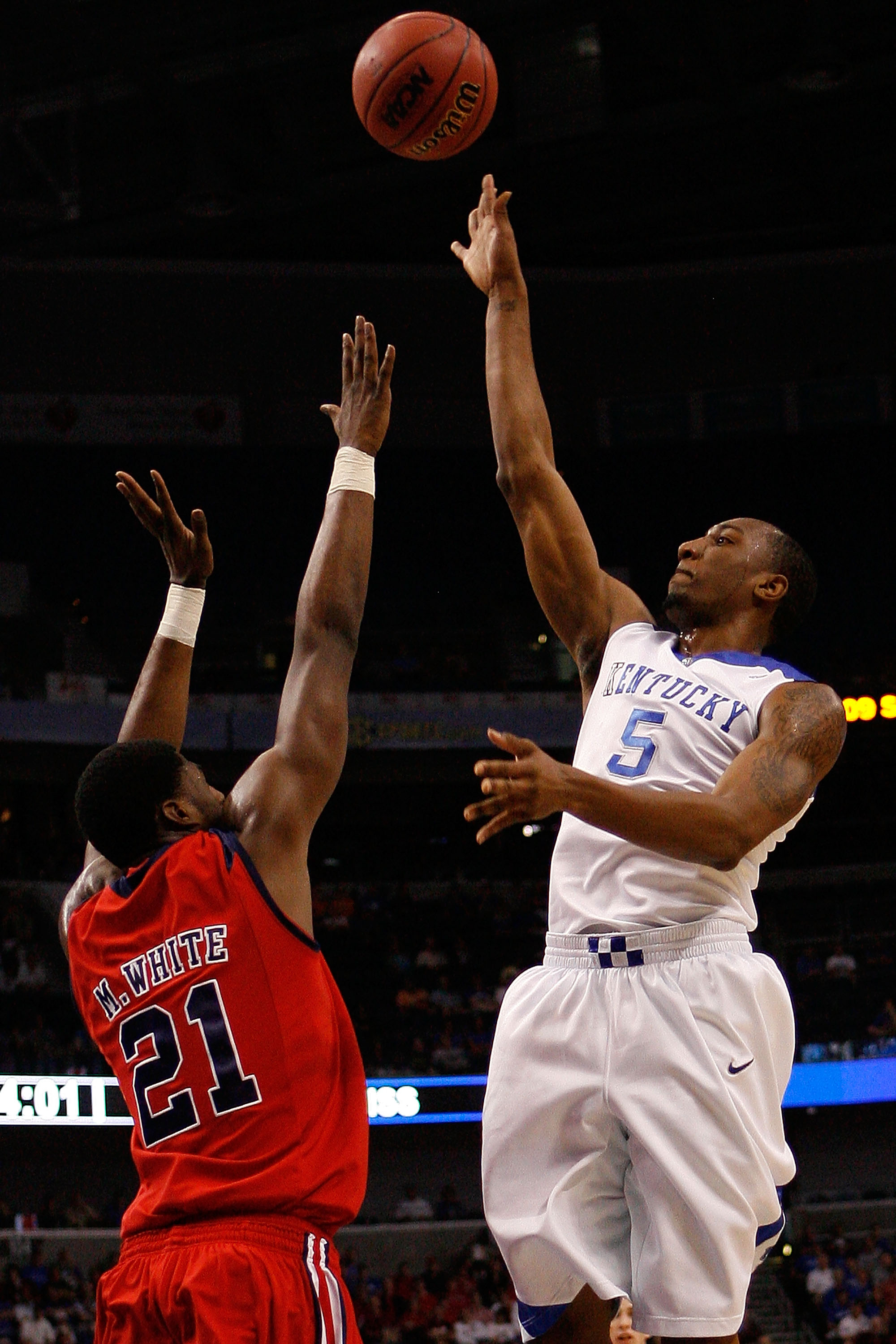 TAMPA, FL - MARCH 12:  Ramon Harris #5 of the Kentucky Wildcats makes a shot over Malcom White #21 of The Ole Miss Rebels during the first round of the SEC Men's Basketball Tournament on March 12, 2009 at The St. Pete Times Forum in Tampa, Florida.  (Phot