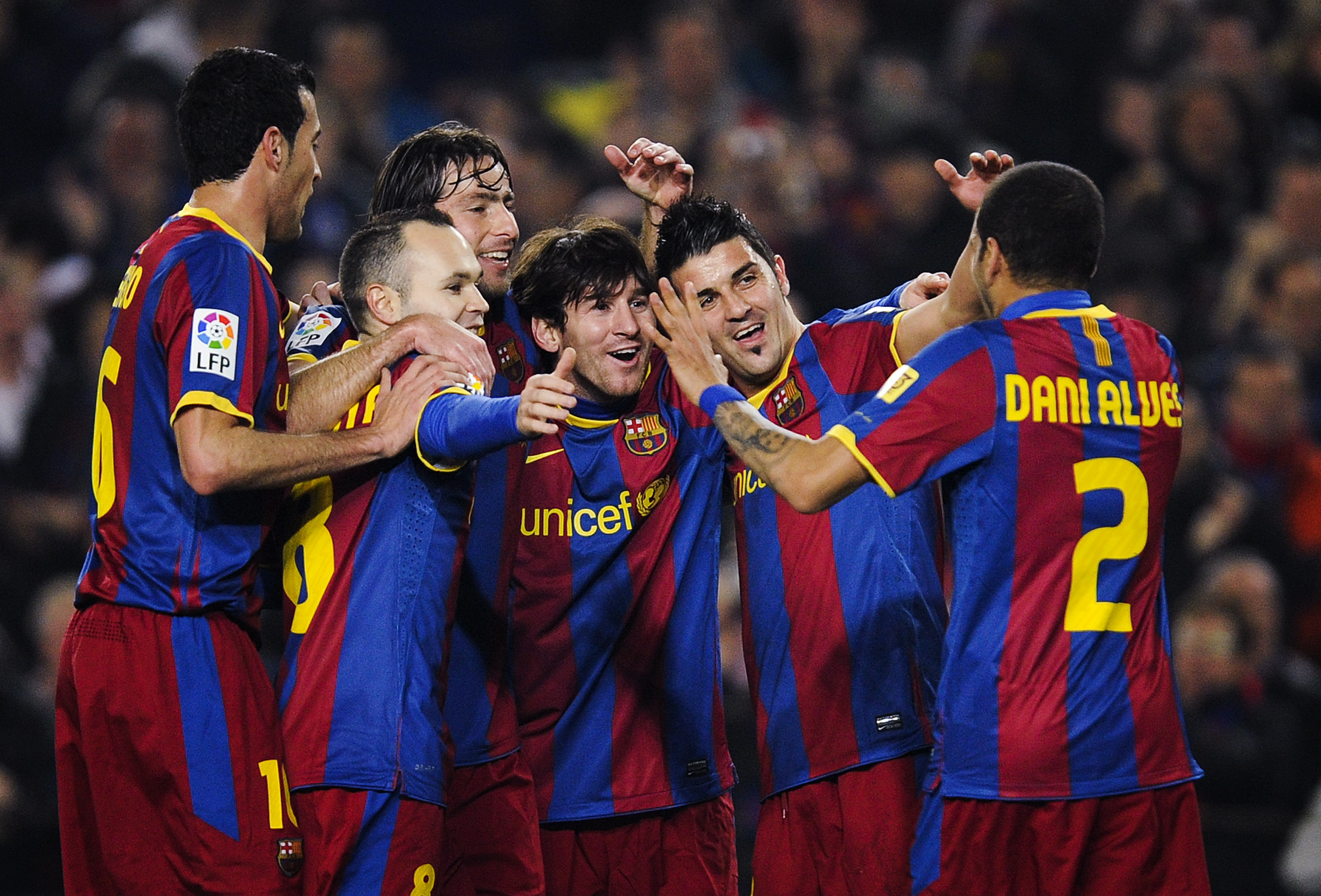 BARCELONA, SPAIN - FEBRUARY 05:  Lionel Messi of Barcelona (3rdR) celebrates with his teammates after scoring his first team's goal during the La Liga match between Barcelona and Atletico de Madrid at Camp Nou on February 5, 2011 in Barcelona, Spain.  (Ph