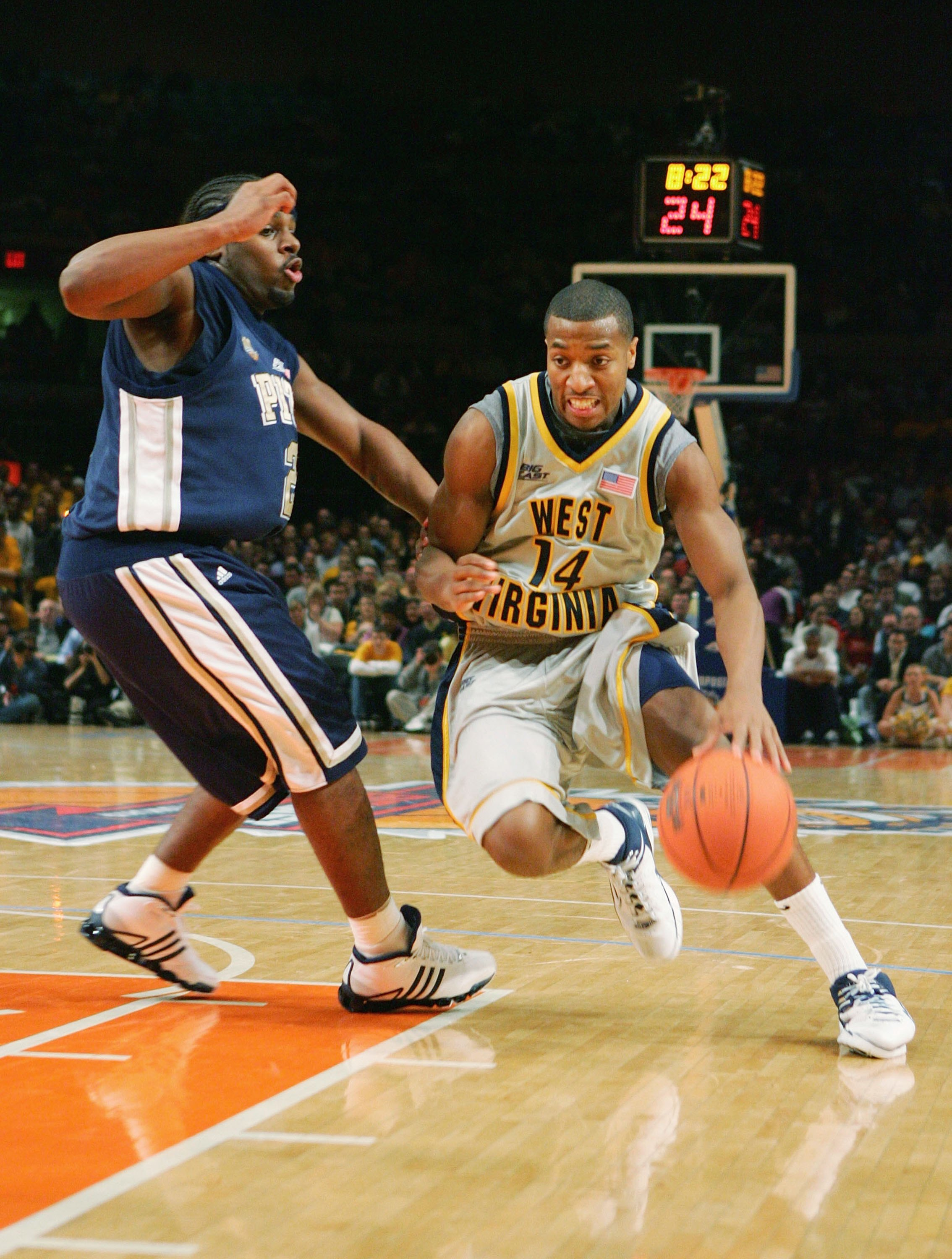 NEW YORK - MARCH 09:  Darris Nichols #14 of the West Virginia Mountaineers drives against Levance Fields #2 of the Pittsburgh Panthers during the quarterfinals of the Big East Men's Basketball Championships at Madison Square Garden March 9, 2006 in New Yo