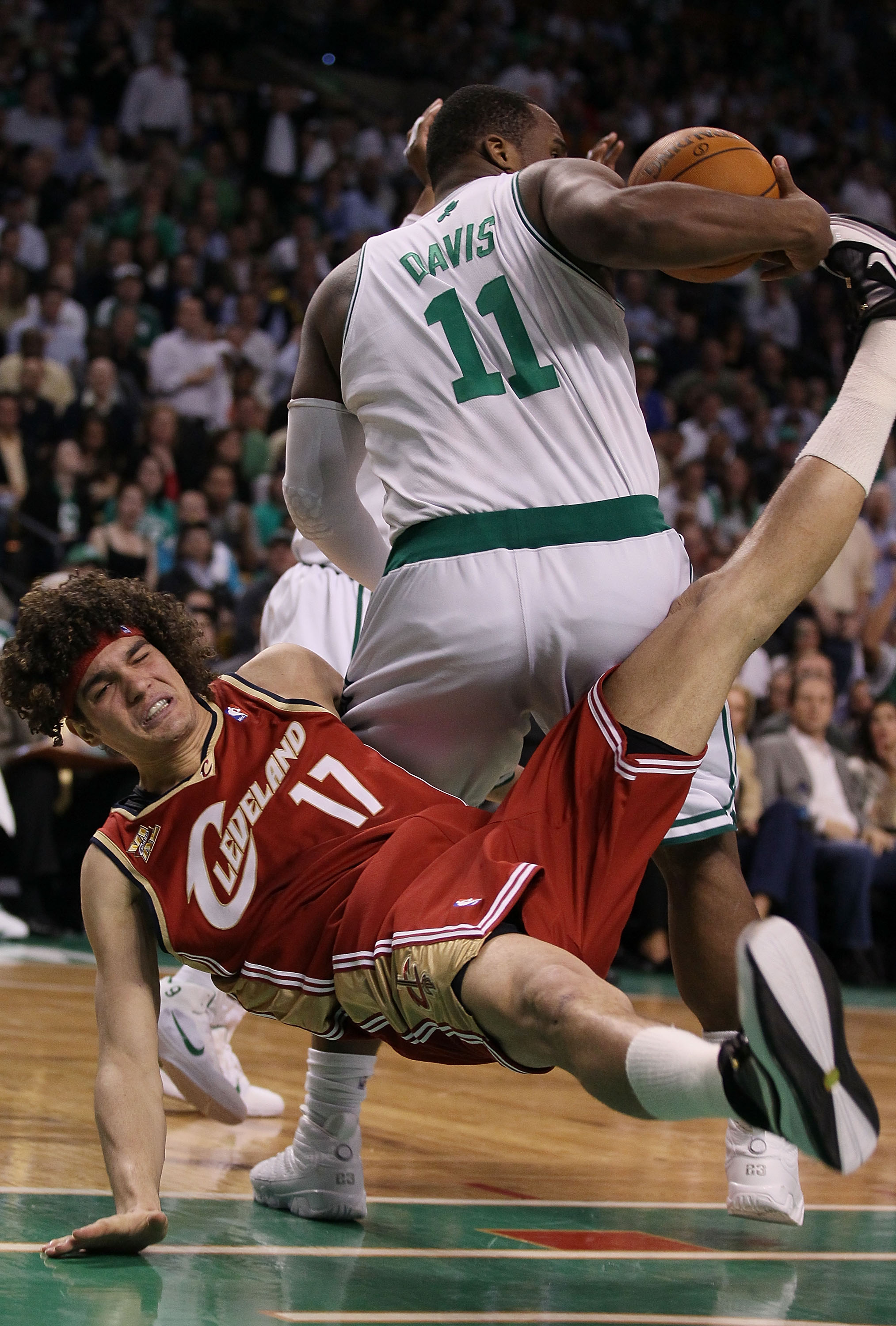 BOSTON - MAY 13:  Glen Davis #11 of the Boston Celtics is called for a loose ball foul on this play as Anderson Varejao #17 of the Cleveland Cavaliers falls to the floor during Game Six of the Eastern Conference Semifinals of the 2010 NBA playoffs at TD G