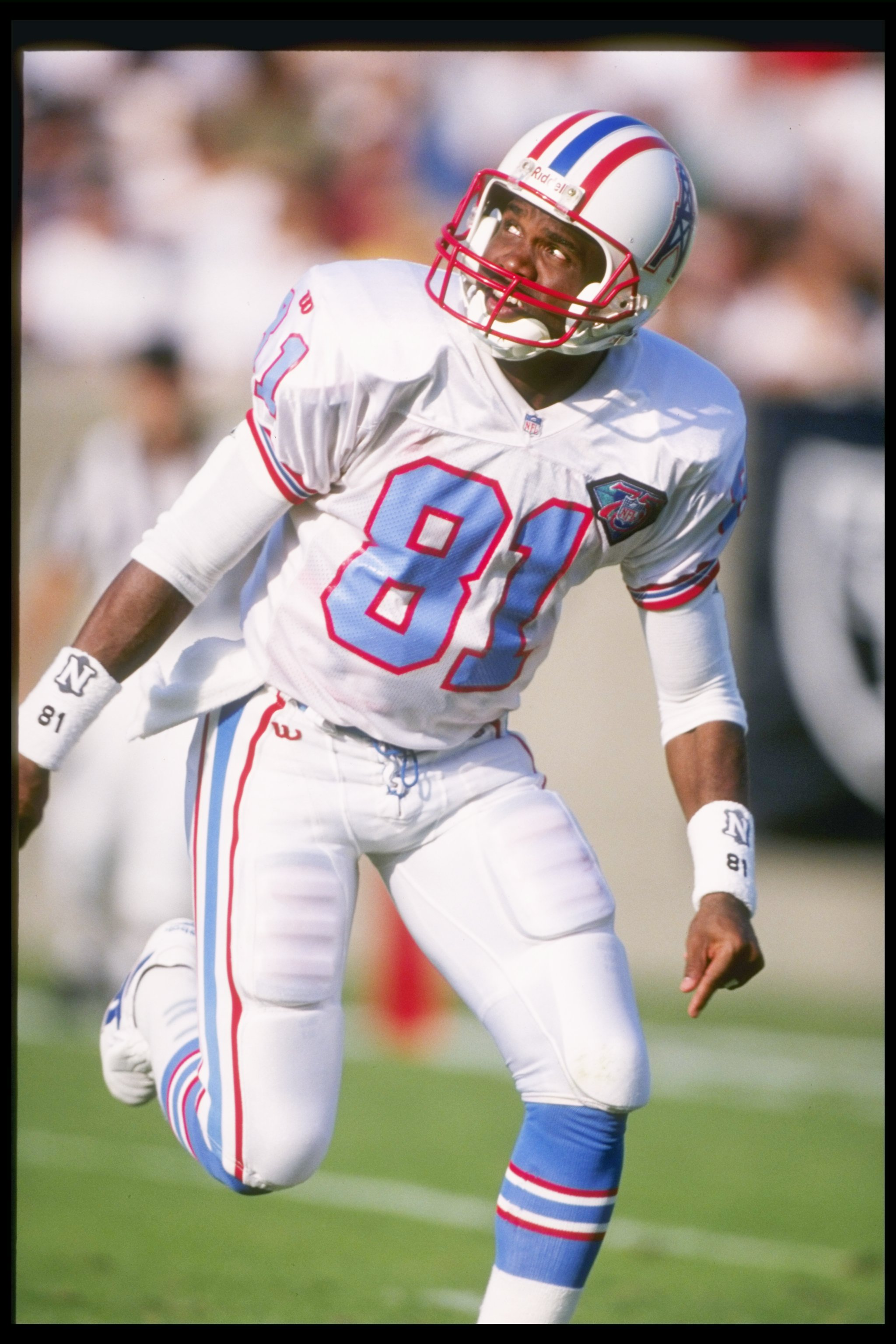 30 Oct 1994:  Houston Oilers wide receiver Ernest Givins looks over his shoulder for a pass during game against the Los Angeles Raiders at Los Angeles Memorial Colesium in Los Angeles, California.  The Raiders won the game 17-14. Mandatory Credit: Al Bell