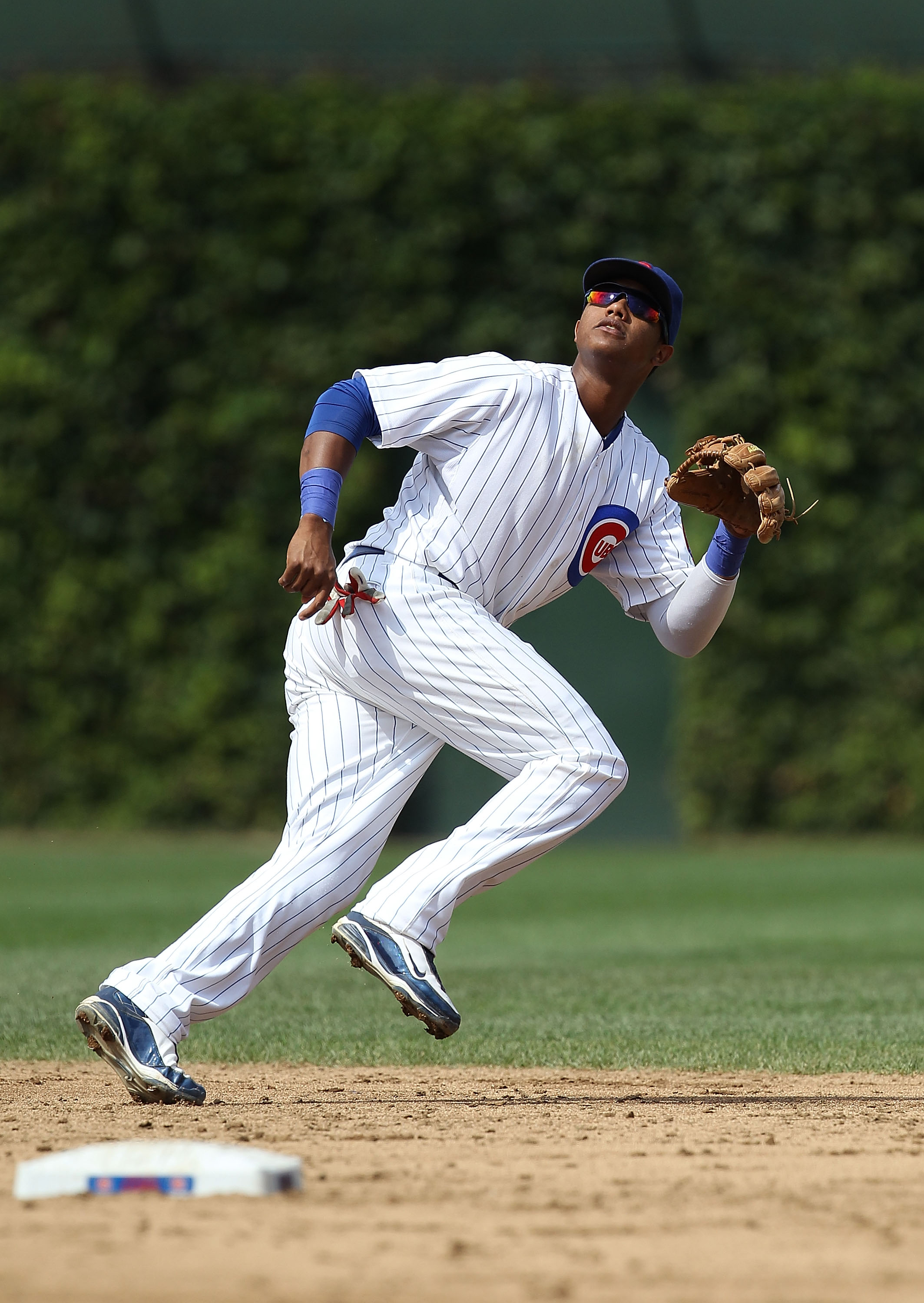 CHICAGO - SEPTEMBER 05: Starlin Castro #13 of the Chicago Cubs chases a fly ball against the New York Mets at Wrigley Field on September 5, 2010 in Chicago, Illinois. The Mets defeated the Cubs 18-5. (Photo by Jonathan Daniel/Getty Images)