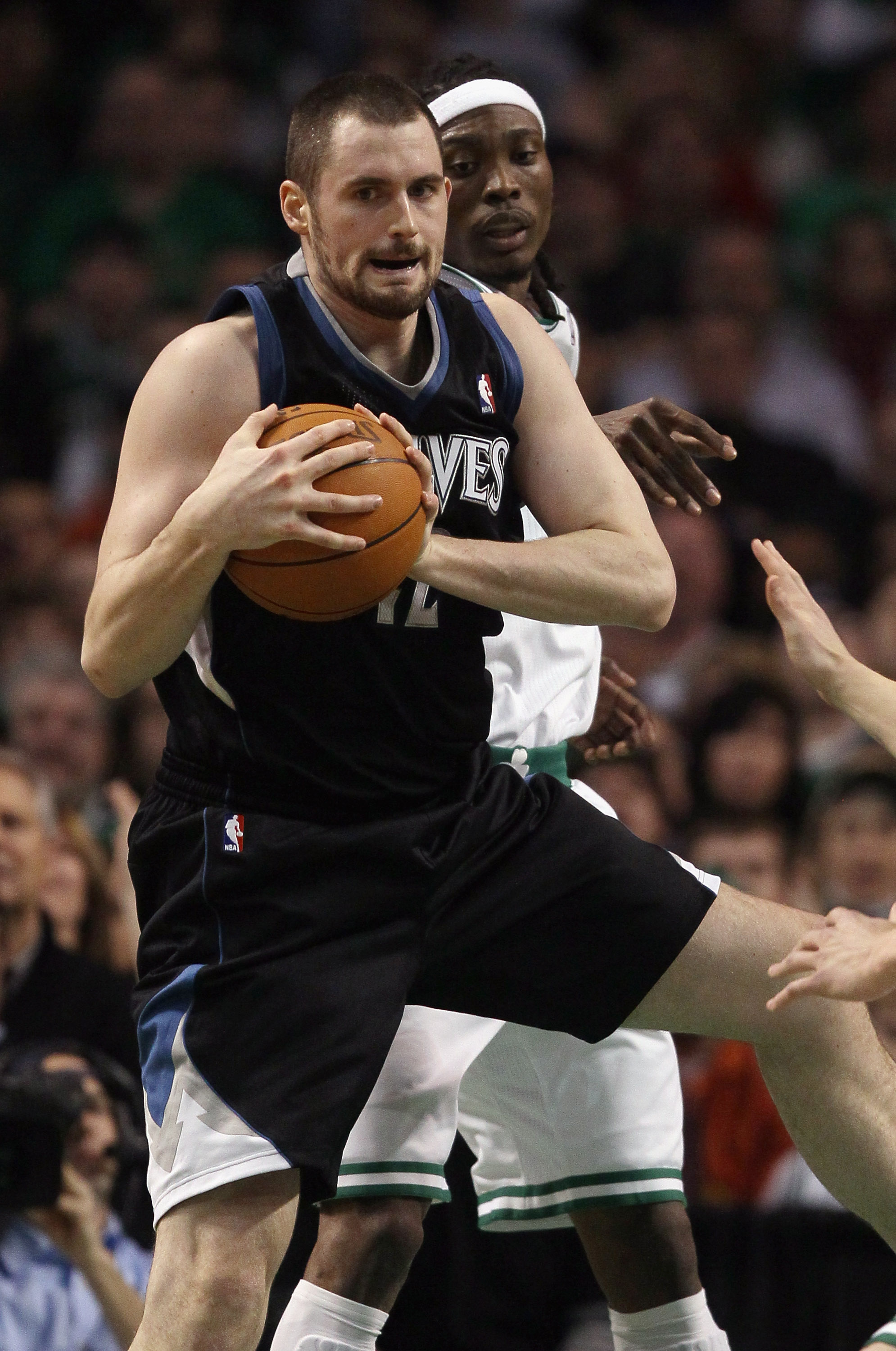 BOSTON, MA - JANUARY 03:  Kevin Love #42 of the Minnesota Timberwolves grabs the rebound before Marquis Daniels #8 of the Boston Celtics on January 3, 2011 at the TD Garden in Boston, Massachusetts. NOTE TO USER: User expressly acknowledges and agrees tha
