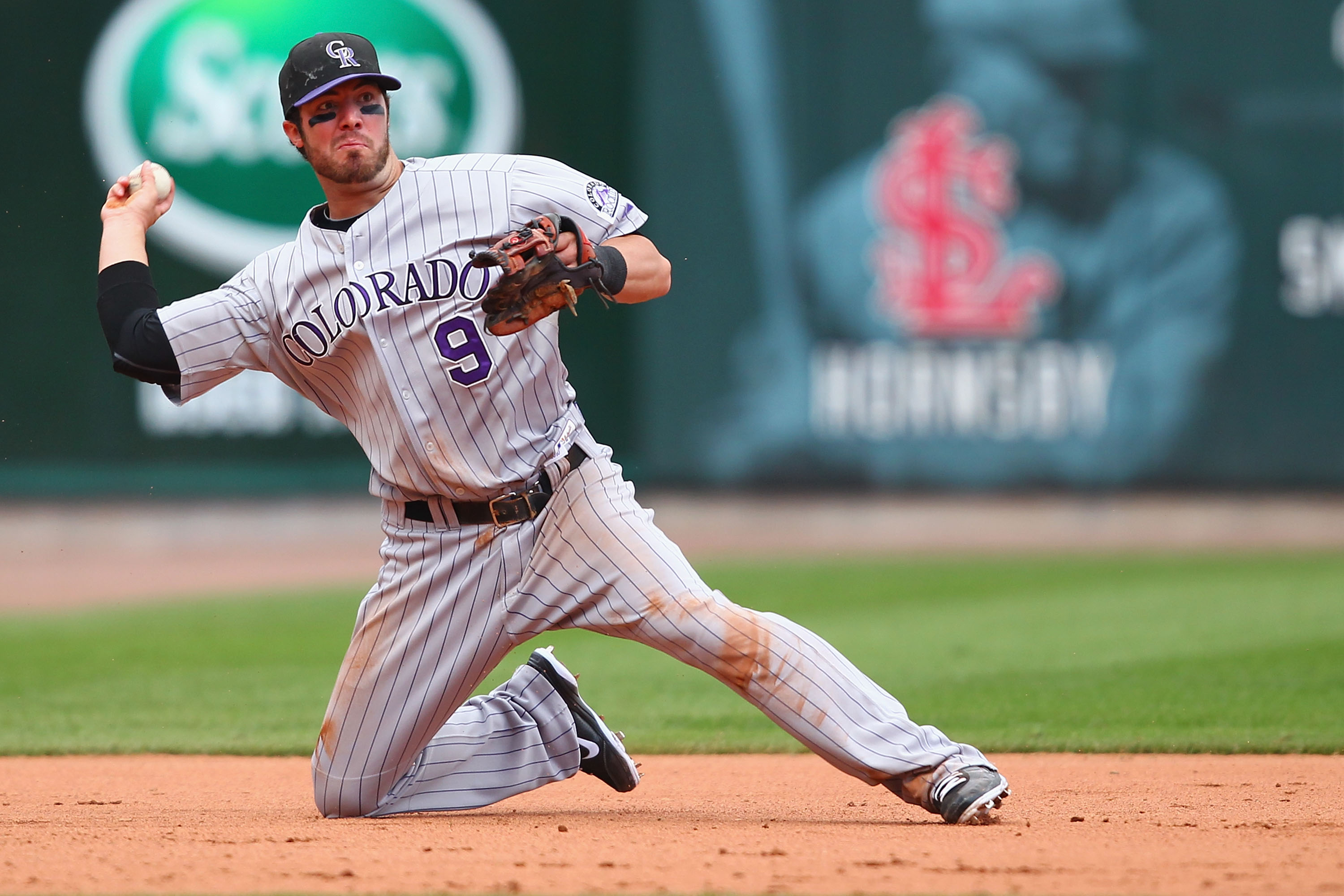 ST. LOUIS - OCTOBER 2: Ian Stewart #9 of the Colorado Rockies throws to first base against the St. Louis Cardinals at Busch Stadium on October 2, 2010 in St. Louis, Missouri.  The Cardinals beat the Rockies 1-0 in 11 innings.  (Photo by Dilip Vishwanat/Ge