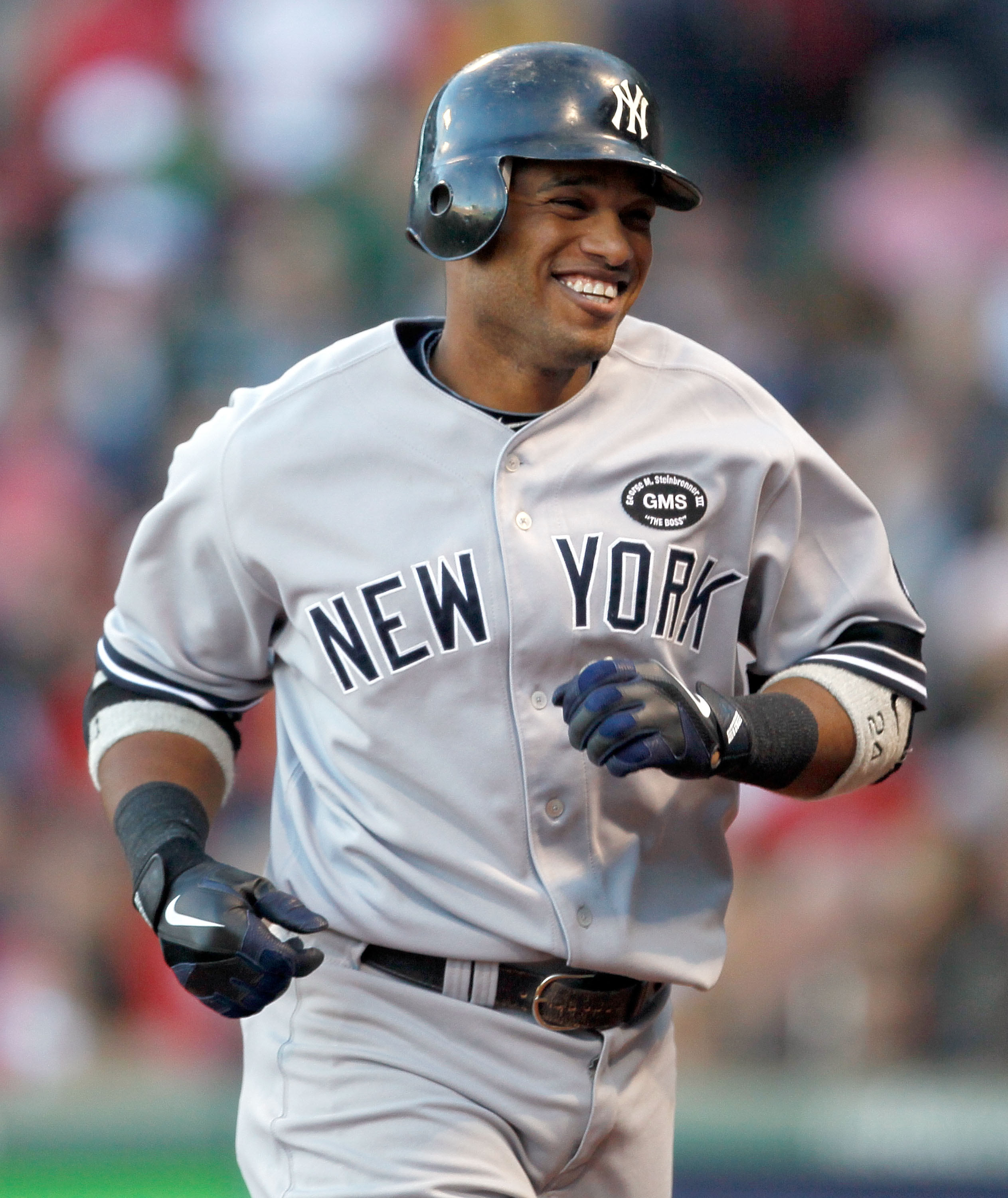 BOSTON - OCTOBER 2:  Robinson Cano #24 of the New York Yankees smiles after hitting a solo home run in the third inning during the first game of a doubleheader against the Boston Red Sox at Fenway Park October 2, 2010 in Boston, Massachusetts. (Photo by J