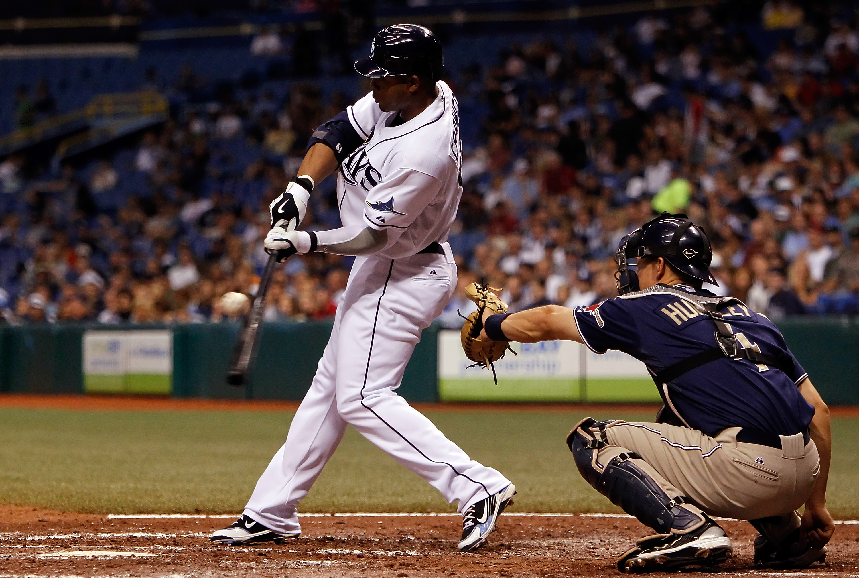 ST. PETERSBURG - JUNE 22:  Outfielder Carl Crawford #13 of the Tampa Bay Rays fouls off a pitch against the San Diego Padres during the game at Tropicana Field on June 22, 2010 in St. Petersburg, Florida.  (Photo by J. Meric/Getty Images)