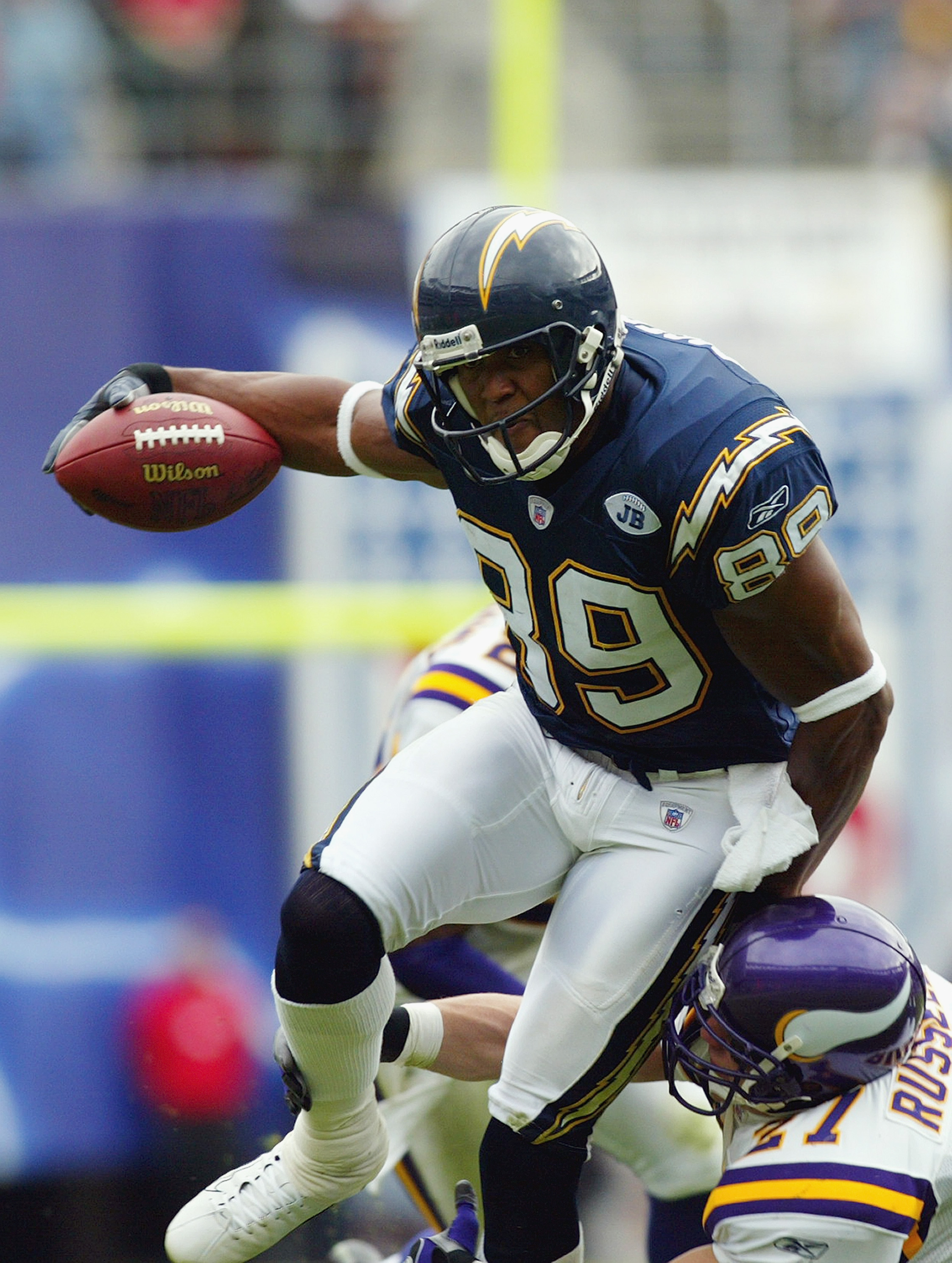 SAN DIEGO - NOVEMBER 9:  David Boston #89 of the San Diego Chargers runs past Brian Russell #27 of the Minnesota Vikings on November 9, 2003 at Qualcomm Stadium in San Diego, California.  The Chargers defeated the Vikings 42-28.  (Photo by Donald Miralle/