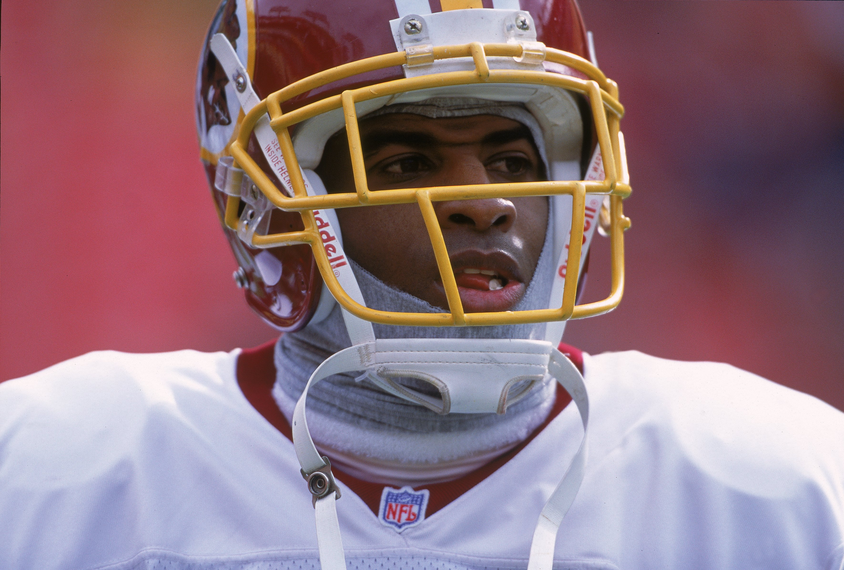 3 Dec 2000:  Deion Sanders #21 of the Washington Redskins watches the action during the game against the New York Giants at the FedEx Field in Landover, Maryland. The Giants defeated the Redskins 9-7.Mandatory Credit: Jamie Squire  /Allsport