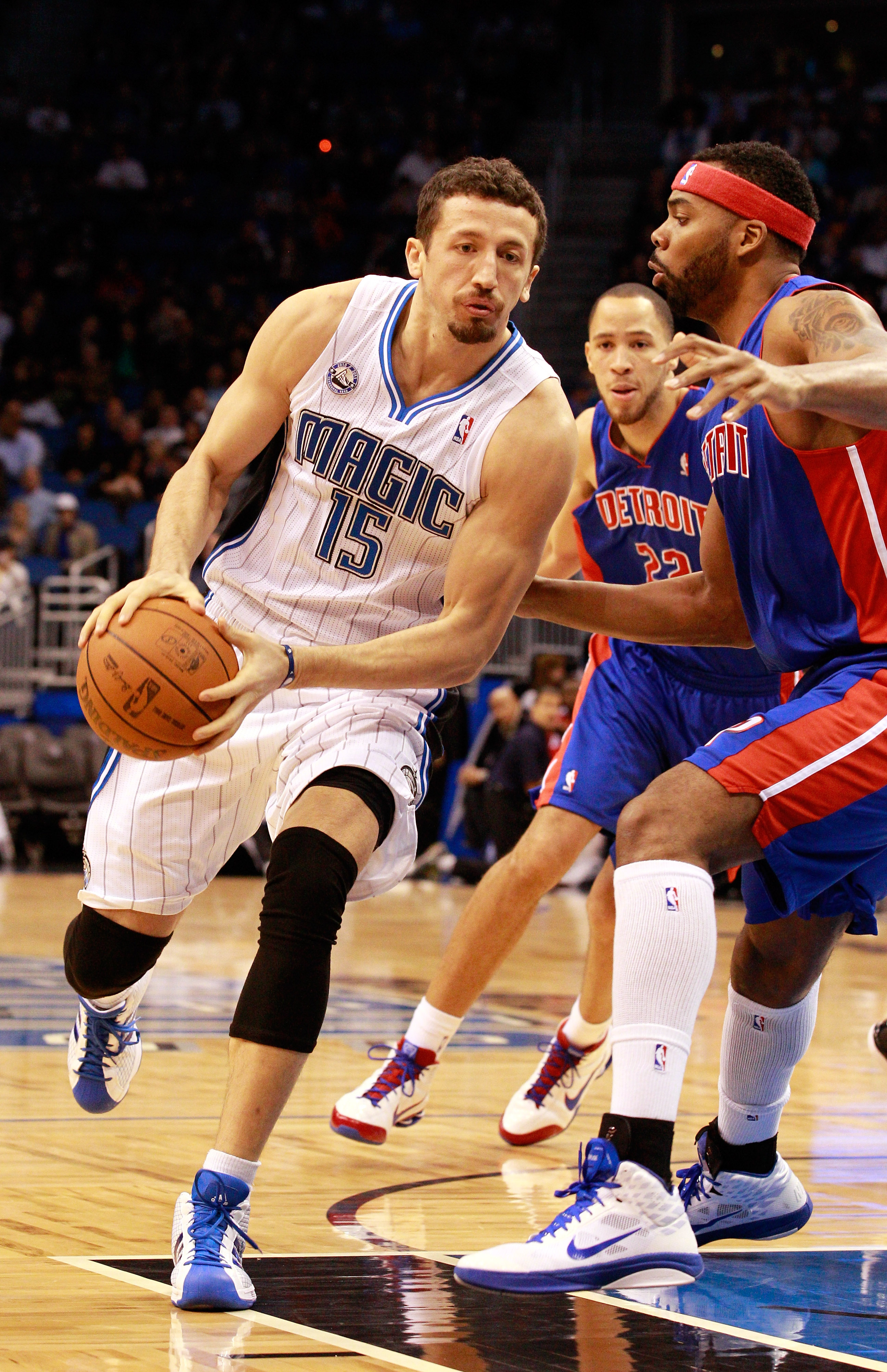 ORLANDO, FL - JANUARY 24:  Hedo Turkoglu #15 of the Orlando Magic drives against Ben Wallace #6 of the Detroit Pistons during the game at Amway Arena on January 24, 2011 in Orlando, Florida.  NOTE TO USER: User expressly acknowledges and agrees that, by d