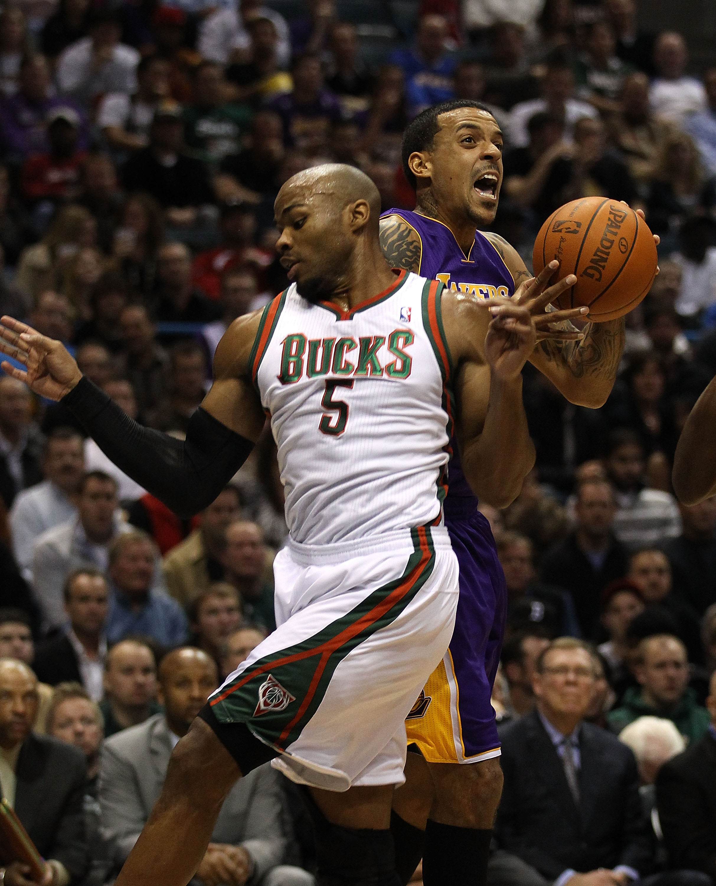 MILWAUKEE - NOVEMBER 16: Corey Maggette #5 of the Milwaukee Bucks fouls Matt Barnes #9 of the Los Angeles Lakers at the Bradley Center on November 16, 2010 in Milwaukee, Wisconsin. NOTE TO USER: User expressly acknowledges and agrees that, by downloading