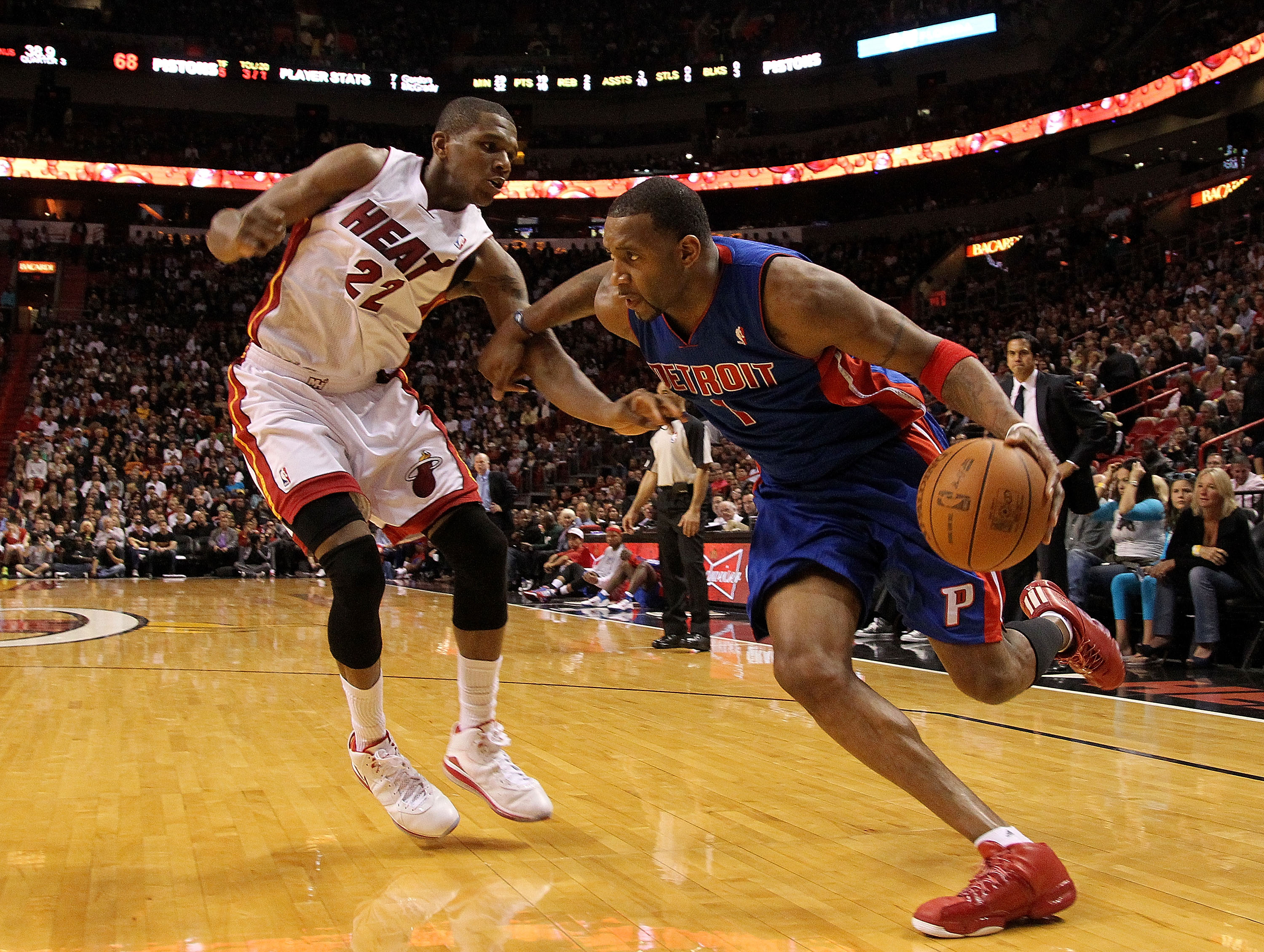 MIAMI, FL - JANUARY 28:  Tracy McGrady #1 of of the Detroit Pistons drives against James Jones #22 of the Miami Heat during a game at American Airlines Arena on January 28, 2011 in Miami, Florida. NOTE TO USER: User expressly acknowledges and agrees that,