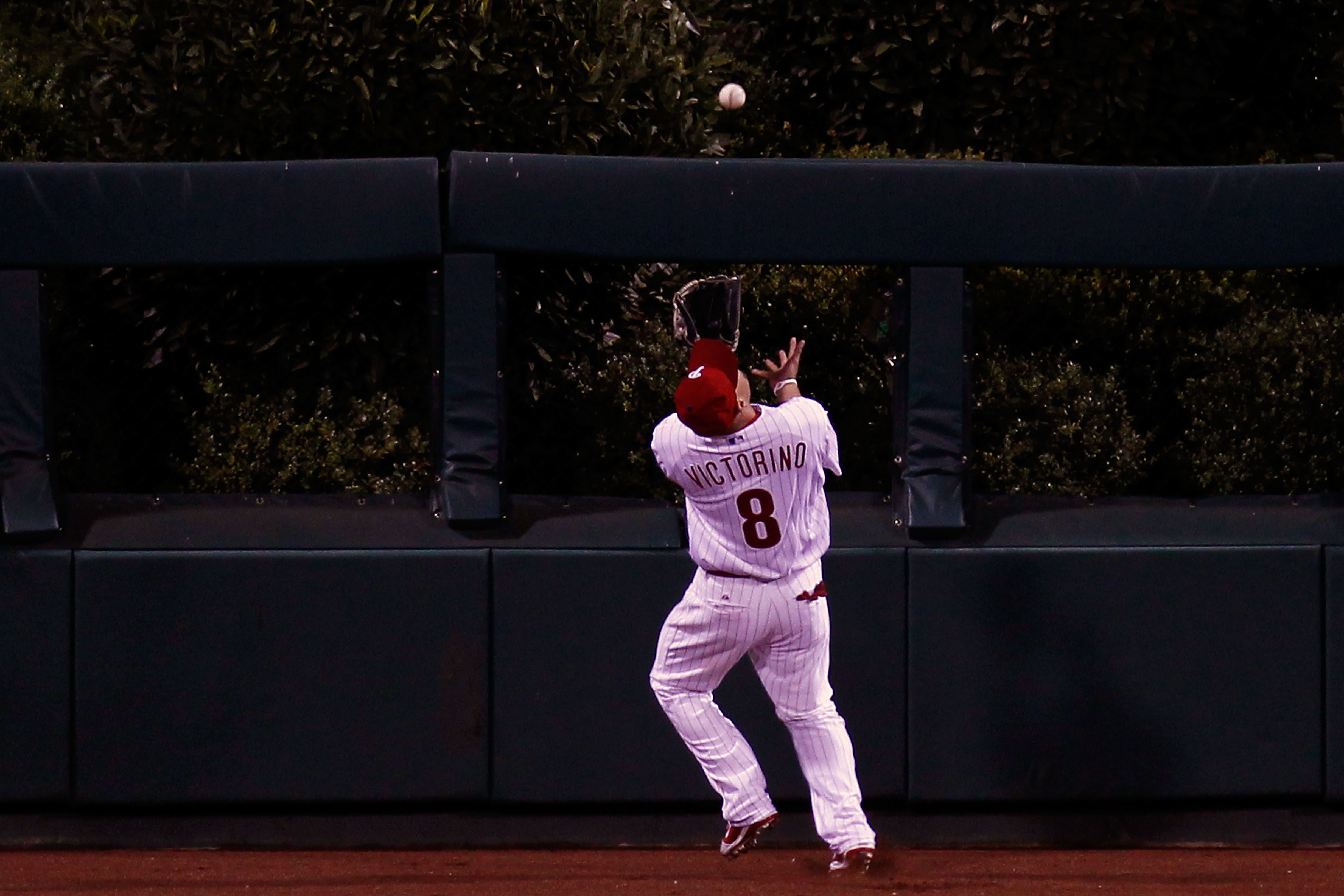 PHILADELPHIA - OCTOBER 23:  Shane Victorino #8 of the Philadelphia Phillies chases down a fly ball in centerfiled against the San Francisco Giants in Game Six of the NLCS during the 2010 MLB Playoffs at Citizens Bank Park on October 23, 2010 in Philadelph