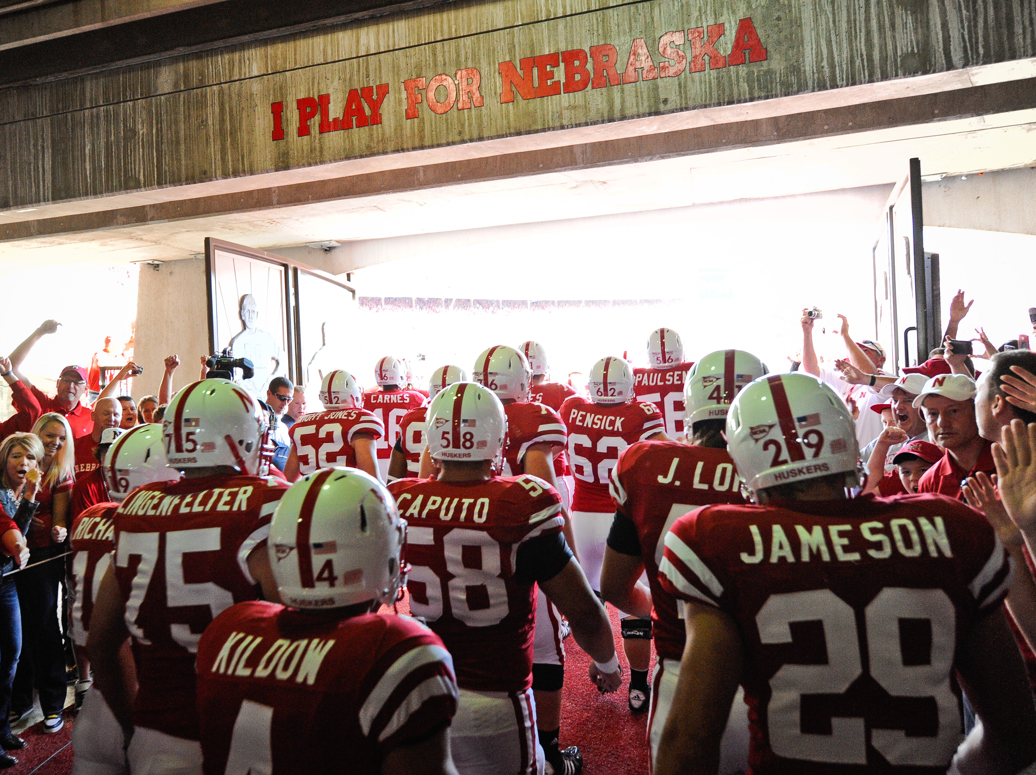 LINCOLN, NE - OCTOBER 16: The Nebraska Cornuskers run through a gauntlet of fans as they take the field against the Texas Longhorns at Memorial Stadium on October 16, 2010 in Lincoln, Nebraska. Texas Defeated Nebraska 20-13. (Photo by Eric Francis/Getty I