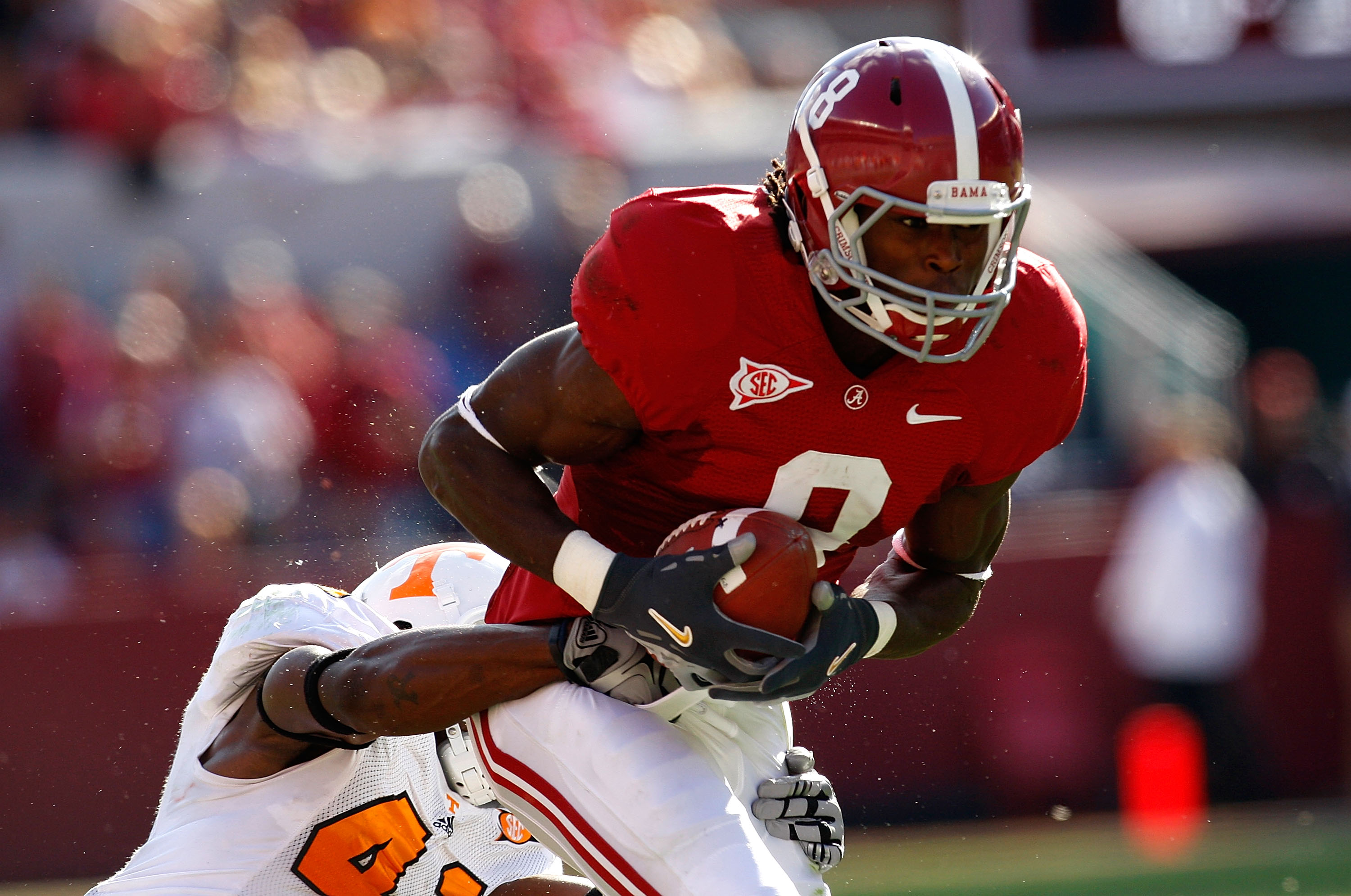 TUSCALOOSA, AL - OCTOBER 24:  Julio Jones #8 of the Alabama Crimson Tide is tackled by Dennis Rogan #41 of the Tennessee Volunteers at Bryant-Denny Stadium on October 24, 2009 in Tuscaloosa, Alabama.  (Photo by Kevin C. Cox/Getty Images)