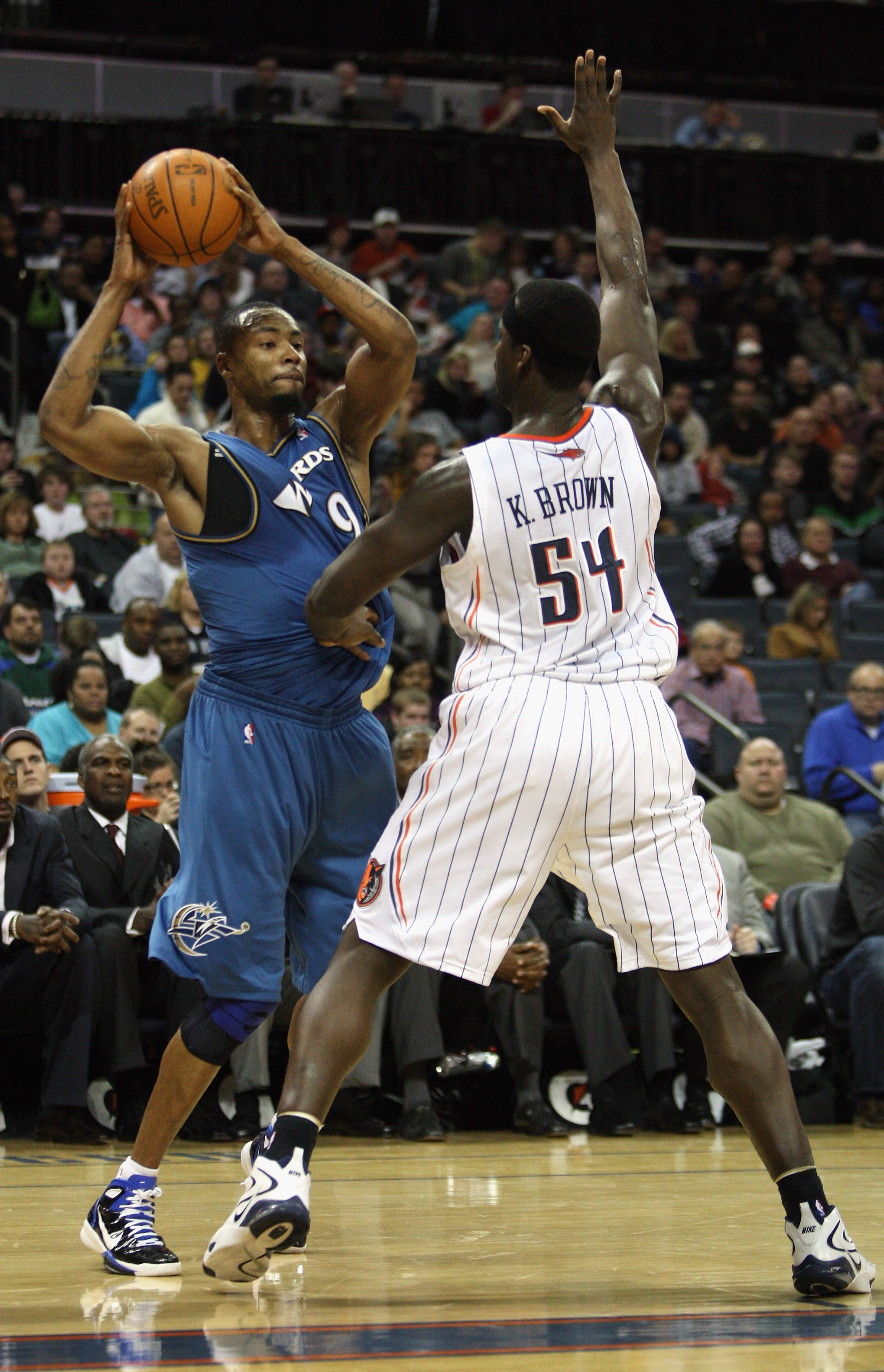 CHARLOTTE, NC - JANUARY 08:  Rashard Lewis #9 of the Washington Wizards looks to pass the ball around Kwame Brown #54 of the Charlotte Bobcats during their game at Time Warner Cable Arena on January 8, 2011 in Charlotte, North Carolina. NOTE TO USER: User