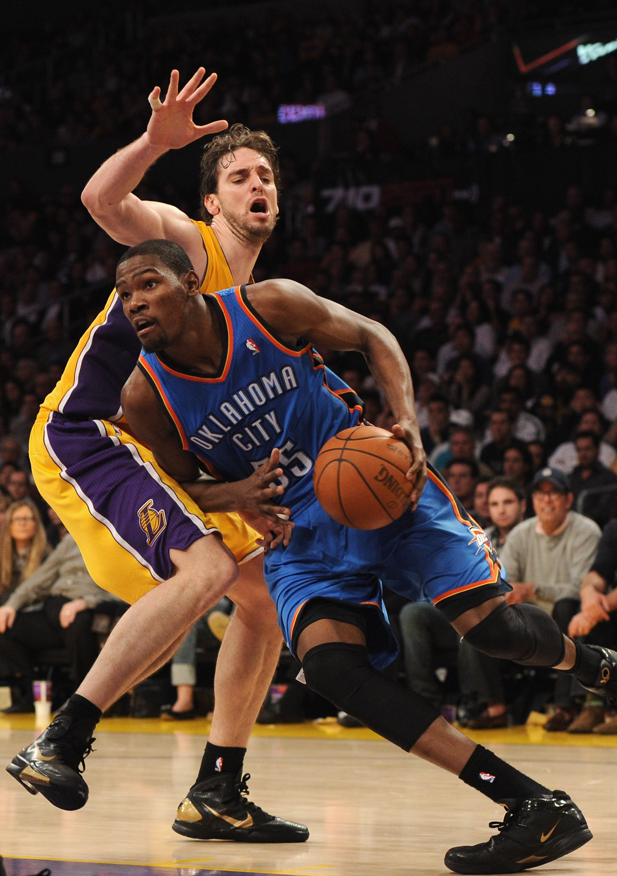 LOS ANGELES, CA - JANUARY 17:  Kevin Durant #35 of the Oklahoma City Thunder dribbles around Pau Gasol #16 of the Los Angeles Lakers during a 101-94 Laker win at the Staples Center on January 17, 2011 in Los Angeles, California.   NOTE TO USER: User expre
