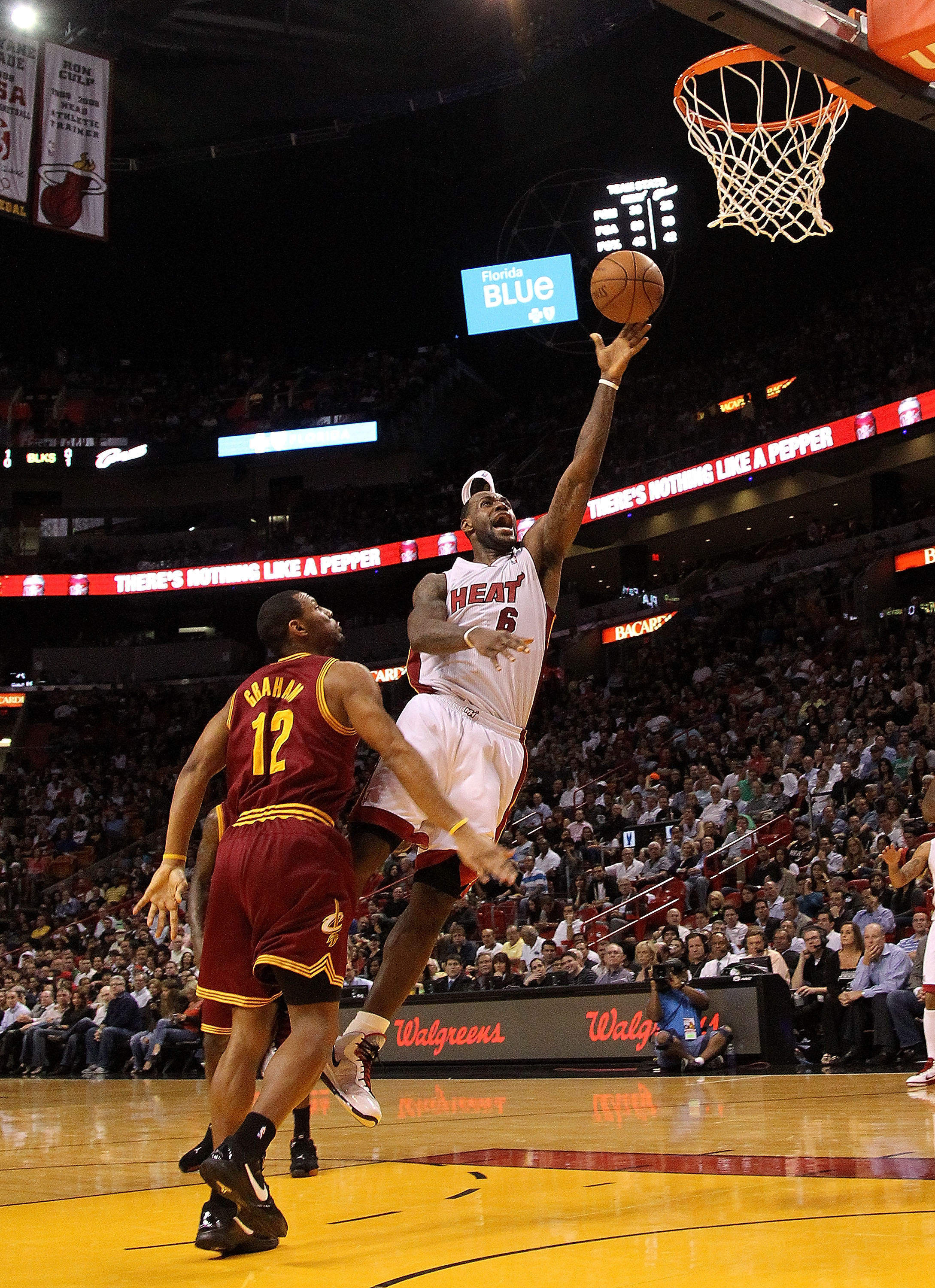 MIAMI, FL - JANUARY 31:  LeBron James #6 of the Miami Heat takes a shot against Joey Graham #12 of the Cleveland Cavaliers during a game at American Airlines Arena on January 31, 2011 in Miami, Florida. NOTE TO USER: User expressly acknowledges and agrees